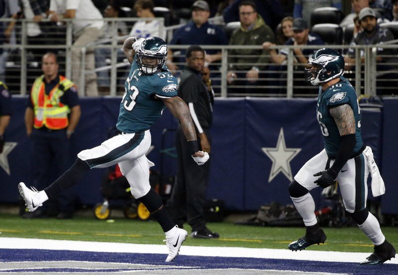 Philadelphia Eagles linebacker Nigel Bradham (53) and Chris Long (56) celebrate a touchdown scored by Bradham after Bradham recovered a Dallas Cowboys' Dak Prescott fumble in the second half of an NFL football game, Sunday, Nov. 19, 2017, in Arlington, Texas. (AP Photo/Michael Ainsworth)<p></p>