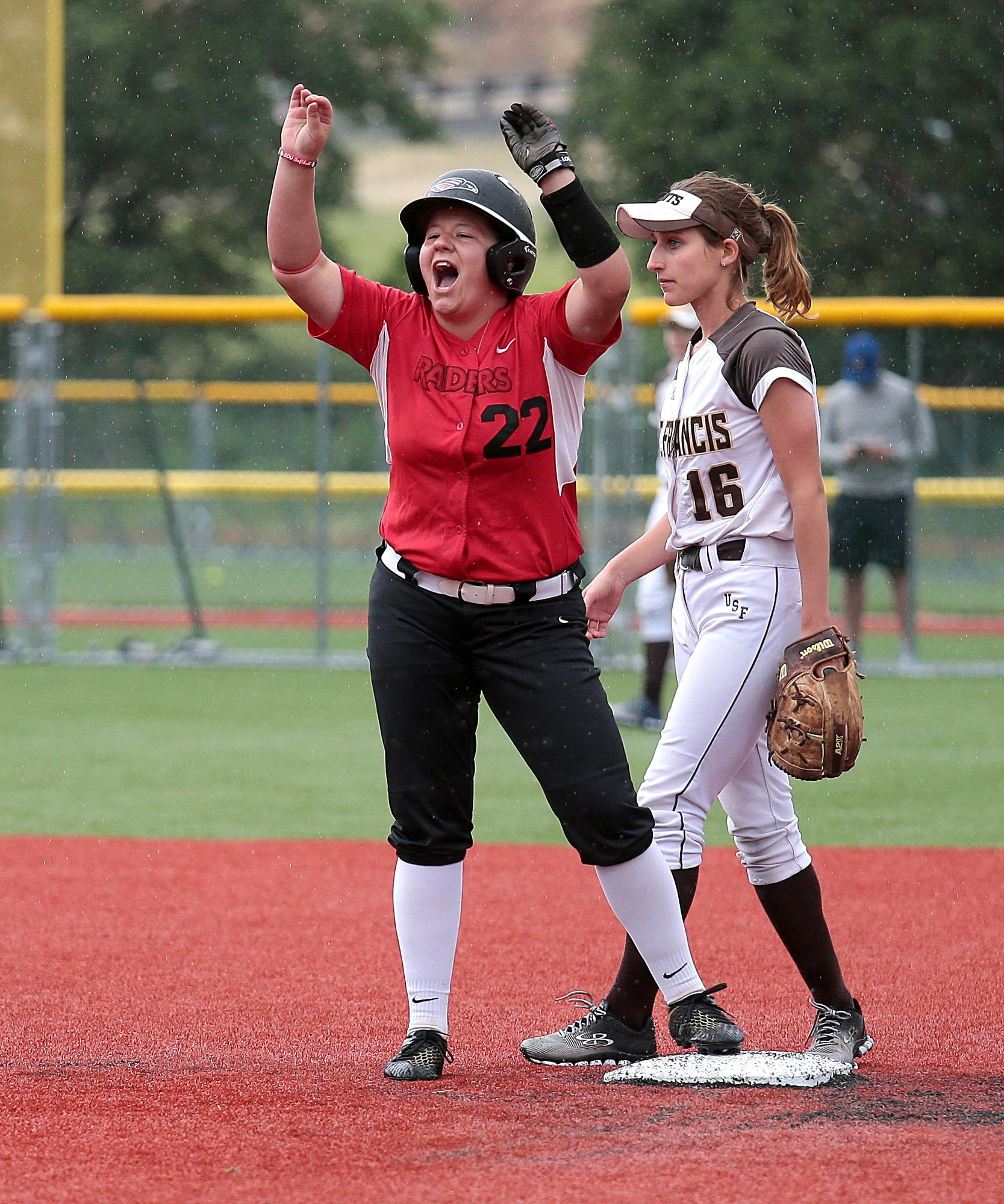 Southern Oregon University sophomore Karlee Coughlin celebrates from second base, after hitting a two-RBI double against St. Francis at US Cellular Community Park on Wednesday.[PHOTO BY:  LARRY STAUTH JR]