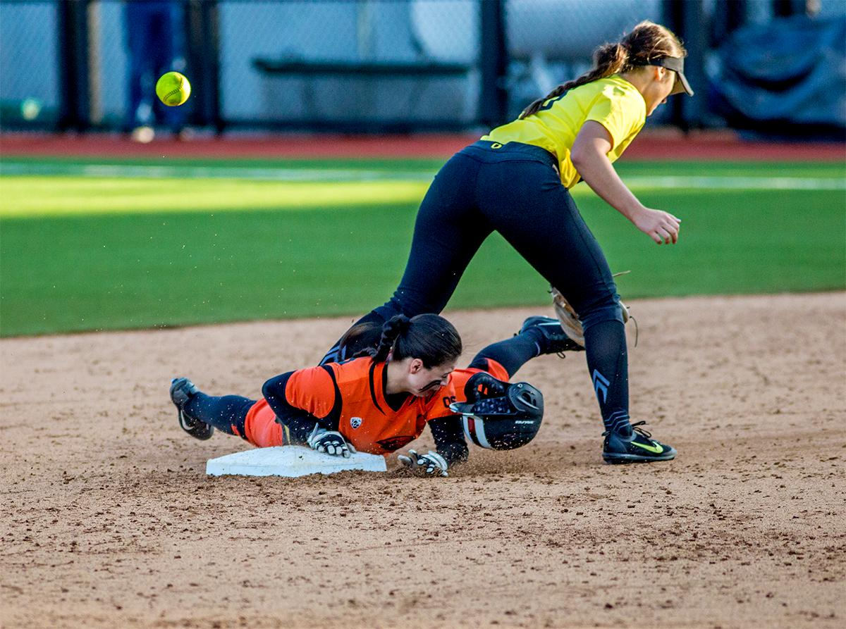 The Beavers' Lovie Lopez (#29) slides into second base losing her helmet in the process. The Oregon Ducks defeated the Oregon State Beavers 8-0 in game one of the three-game Civil War series on Friday night at Jane Sanders Stadium. The game was 0-0 until Gwen Svekis (#21) hit a solo home run in the fourth inning. Mia Camuso hit a grand slam in the fifth inning, ending the game for the Ducks by mercy rule. With tonight's victory, the Ducks are 39-6 and 12-6 in Pac-12 play. Photo by August Frank, Oregon News Lab