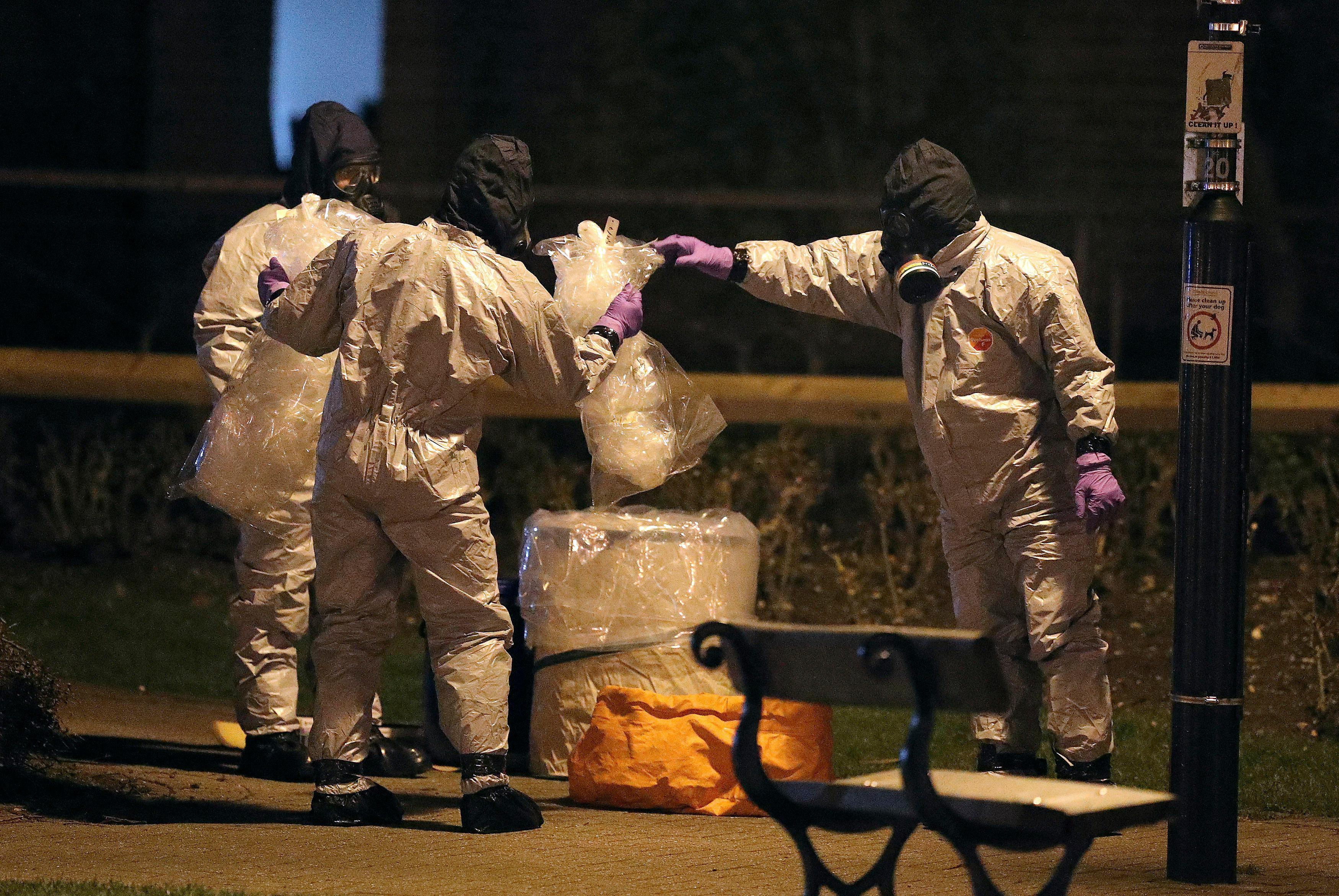"Investigators in protective suits work at the scene in the Maltings shopping centre in Salisbury, England, Tuesday, March 13, 2018. The use of Russian-developed nerve agent Novichok to poison ex-spy Sergei Skripal and his daughter makes it ""highly likely"" that Russia was involved, British Prime Minister Theresa May said Monday. Novichok refers to a class of nerve agents developed in the Soviet Union near the end of the Cold War.(Andrew Matthews/PA via AP)"