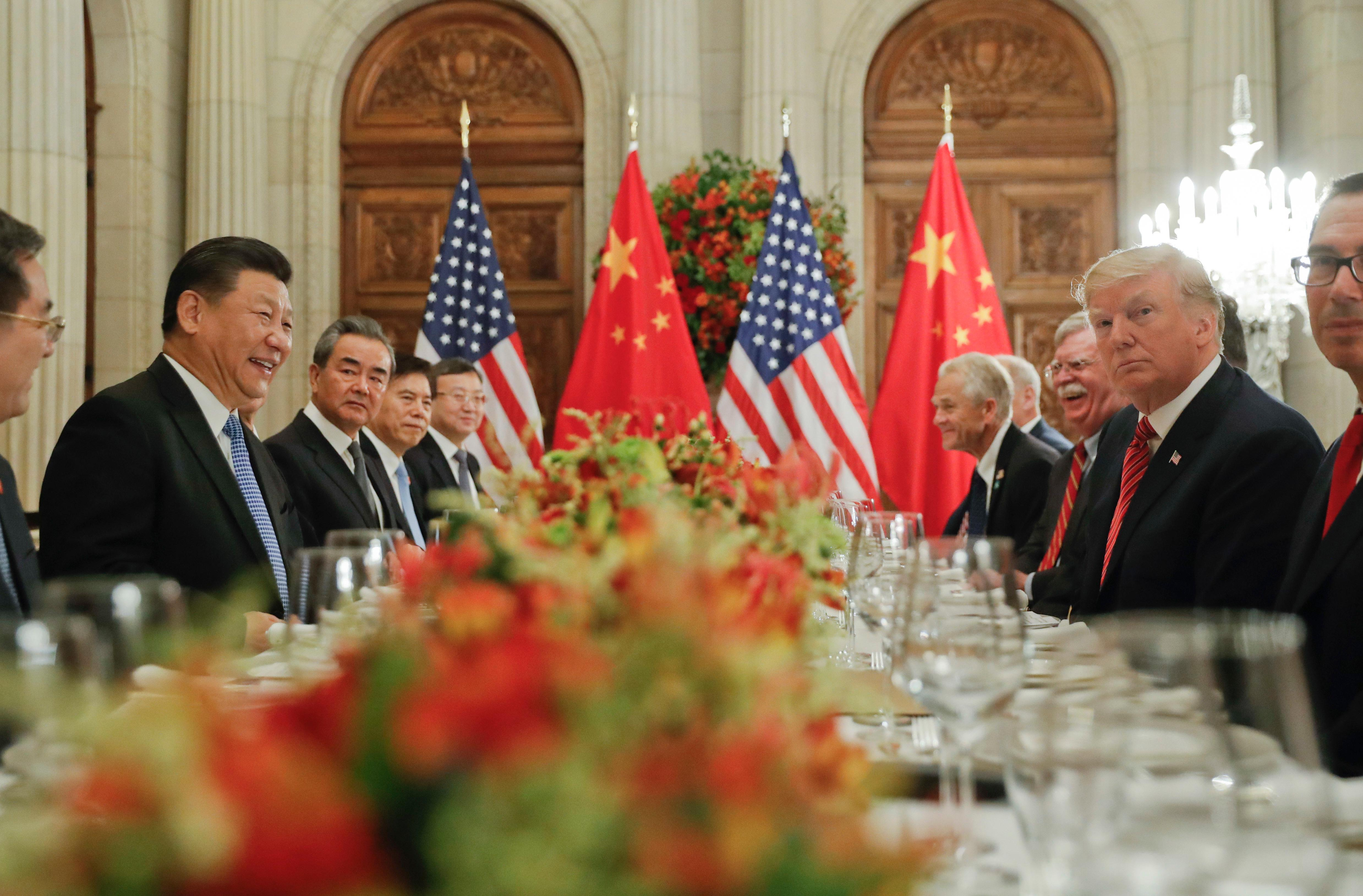 In this Dec. 1, 2018, photo, President Donald Trump, second from right, meets with China's President Xi Jinping, second from left, during their bilateral meeting at the G20 Summit, in Buenos Aires, Argentina. (AP Photo/Pablo Martinez Monsivais, File)