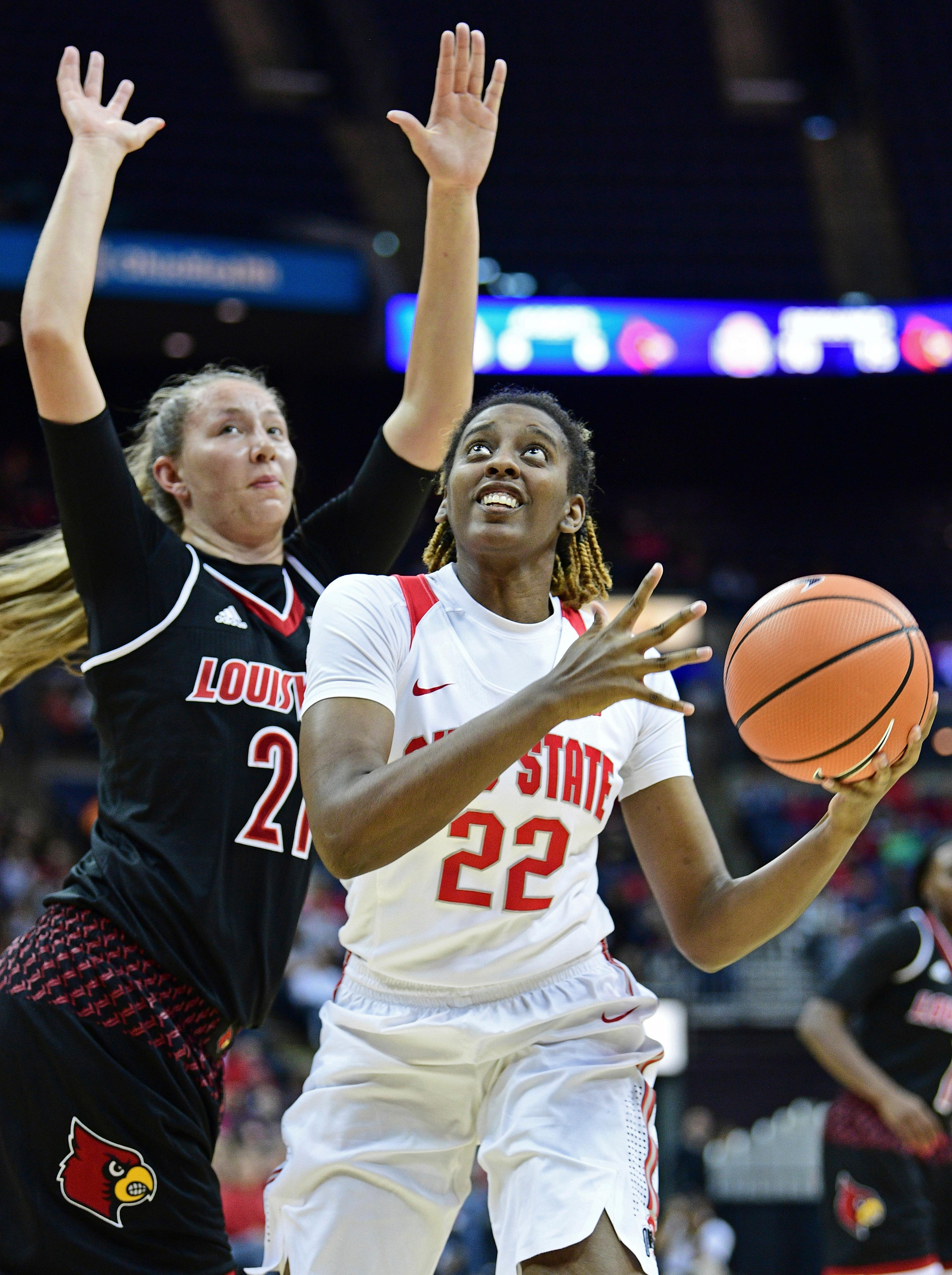 Ohio State's Alexa Hart (22) shoots around Louisville's Kylee Shook during the second quarter of an NCAA college basketball game, Sunday, Nov. 12, 2017, in Columbus, Ohio. (AP Photo/David Dermer)