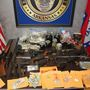 Police: Guns, drugs seized in raid from Benton home