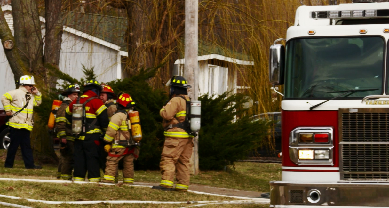 A house fire in Fenton Township has sent two people to the hospital. (Photo: Jeff Vargas/WEYI/WSMH)