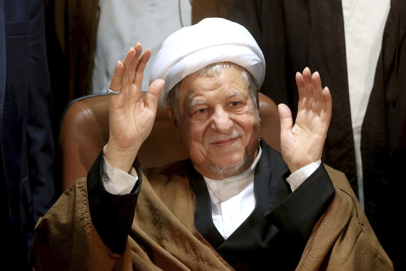 FILE - In this Dec. 21, 2015 file photo, former Iranian President Akbar Hashemi Rafsanjani waves to journalists as he registers his candidacy for the elections of the Experts Assembly, in Tehran, Iran. (AP Photo/Ebrahim Noroozi, File)