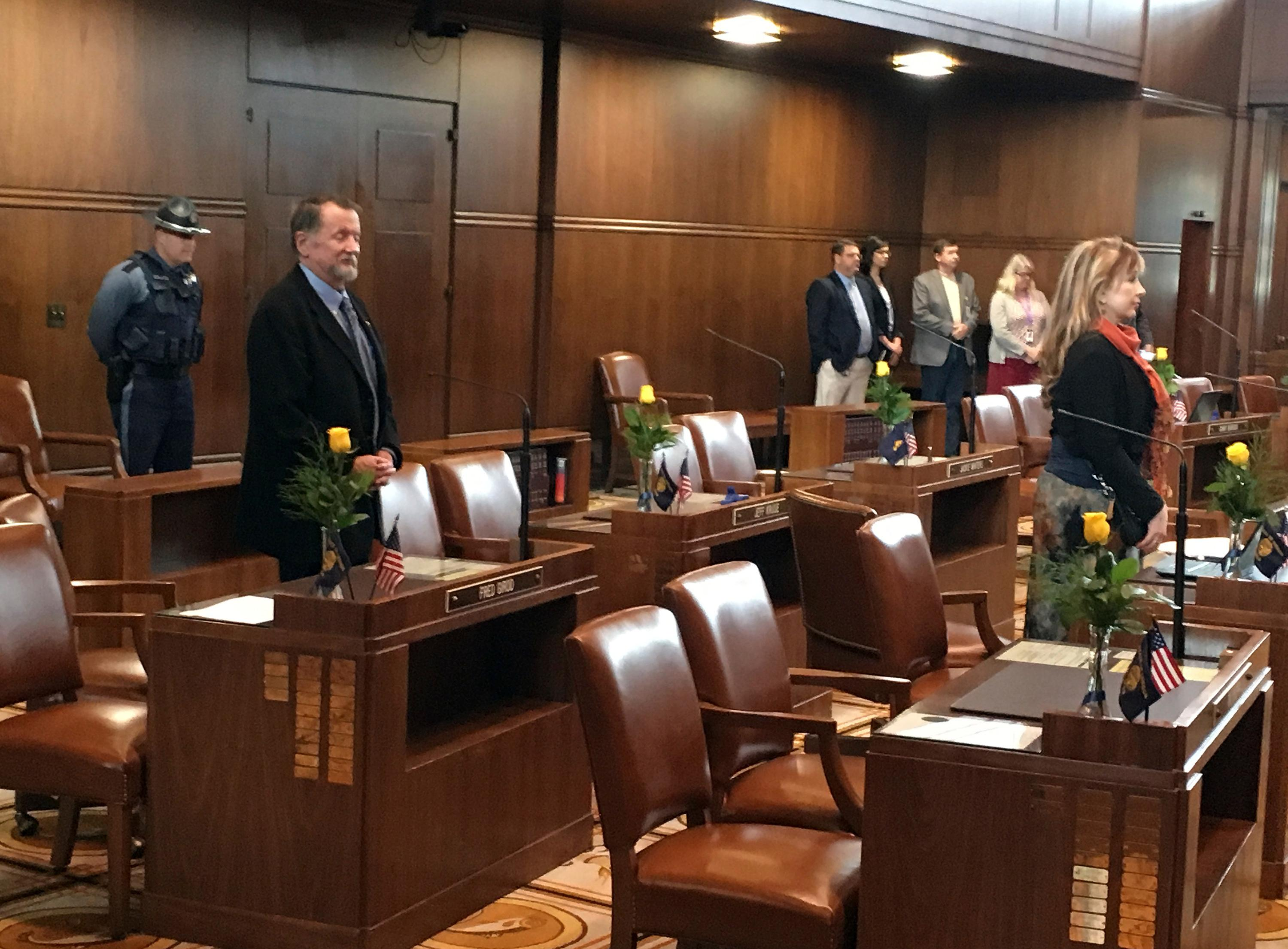 Oregon state Sen. Jeff Kruse's desk, center left, is empty as senators attend Legislative opening ceremonies at the Capitol on Wednesday, Feb. 7, 2018, a day after a report accused him of harassment and the governor and house speaker called for him to resign. Kruse didn't appear as Wednesday's session commenced and he was not in his capitol office. (AP Photo/Andrew Selsky)