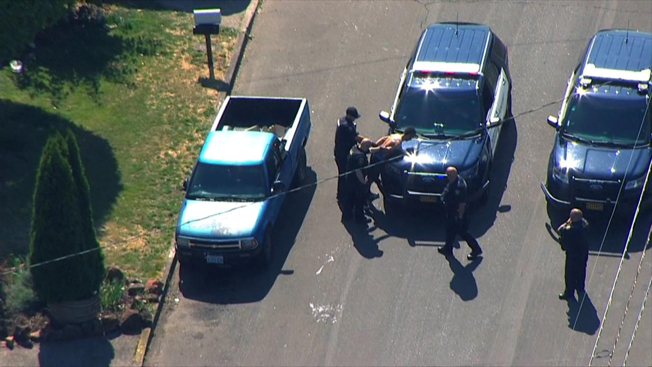 Police take a hit-and-run suspect into custody Monday, July 8, 2019 after a crash at Southeast 148th Avenue and Powell Boulevard left one person dead and several injured. (Photo: Chopper 2/KATU News)