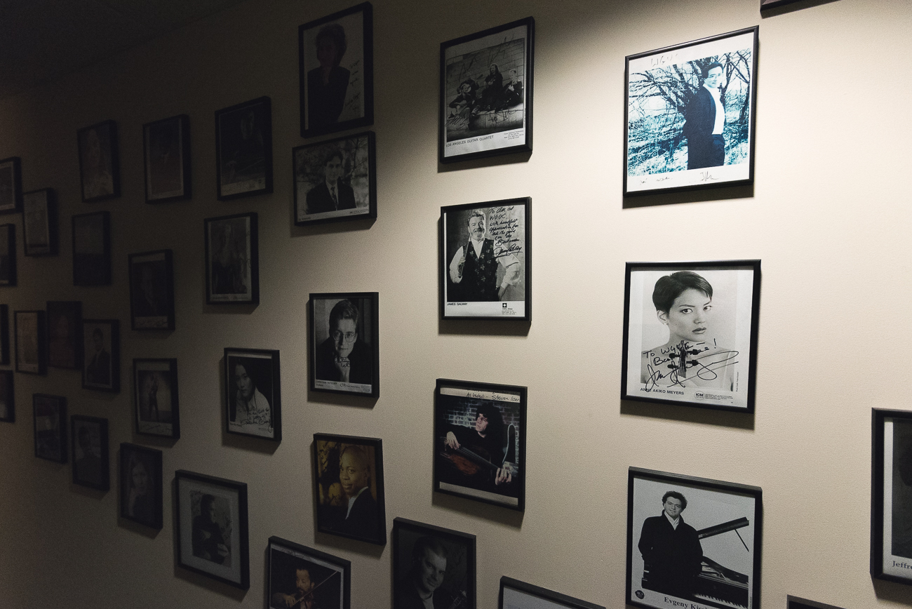 A wall of photos of classical music performers who have come to WGUC over its 50-year lifespan. WVXU shares a floor with WGUC. / Image: Phil Armstrong, Cincinnati Refined // Published: 12.12.17