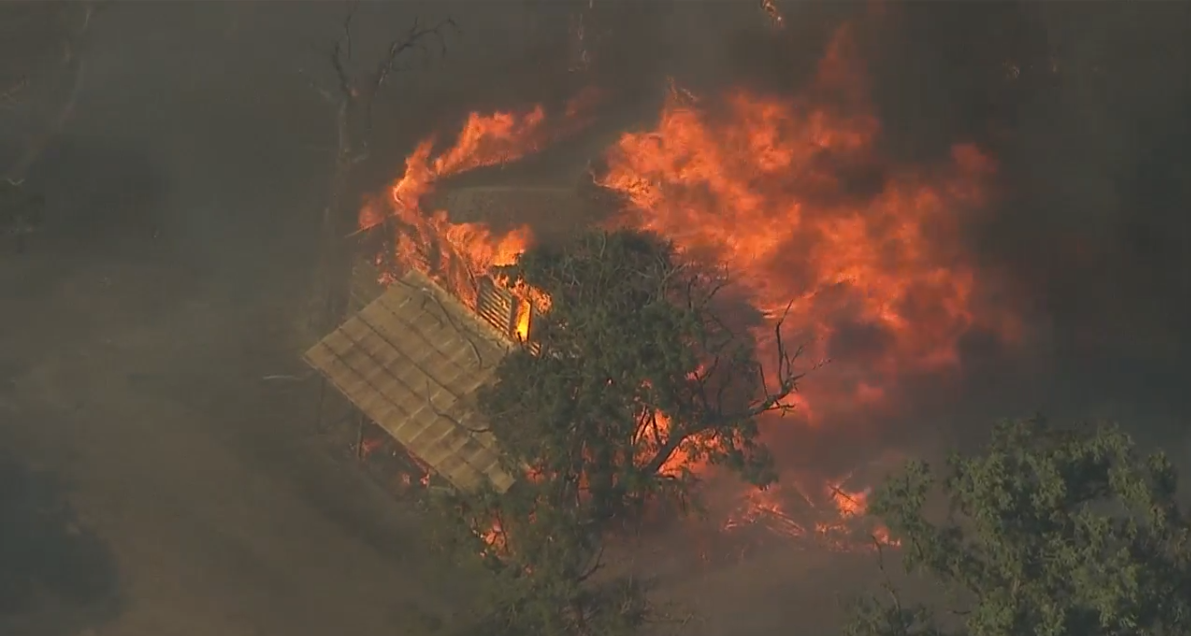 A structure burns in a wildfire east of The Dalles on Tuesday, July 17, 2018. (Photo: Chopper 2/KATU)