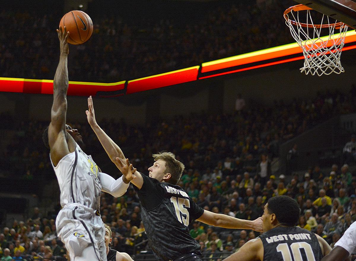 Ducks' Dylan Ennis (#31) rises above Army's Jacob Kessler (#15) for two points. In front of a sold out crowd, Oregon defeated Army 91-77 on opening night. Photo by Jacob Smith, Oregon News Lab