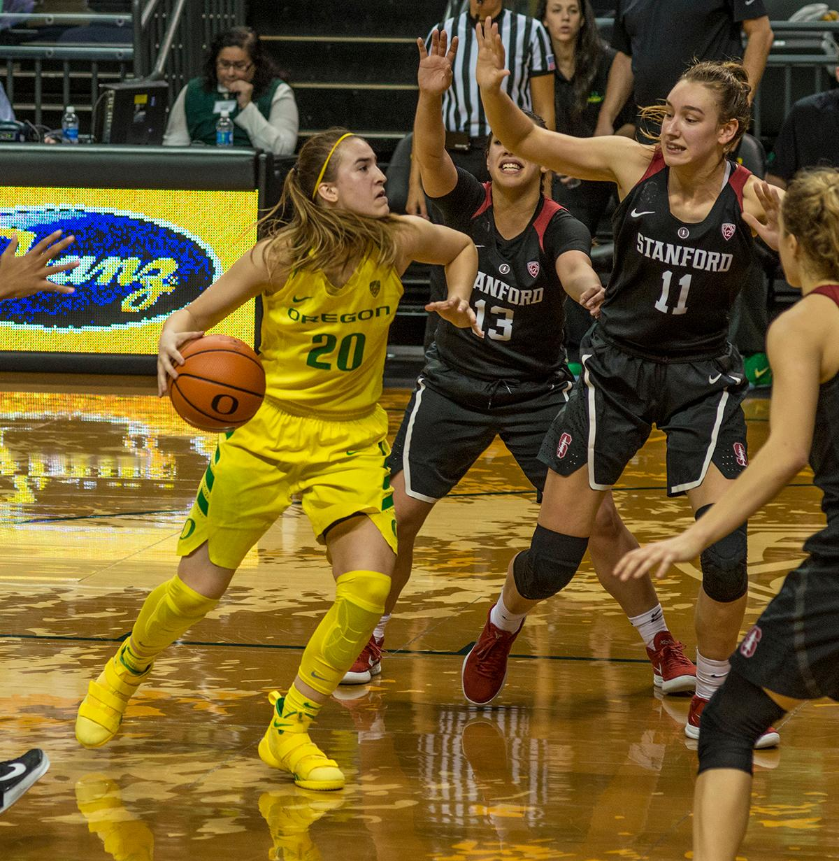 Oregon Ducks Sabrina Ionescu (#20) attempts to drive against the Stanford Cardinal defense. The Stanford Cardinal defeated the Oregon Ducks 78-65 on Sunday afternoon at Matthew Knight Arena. Stanford is now 10-2 in conference play and with this loss the Ducks drop to 10-2. Leading the Stanford Cardinal was Brittany McPhee with 33 points, Alanna Smith with 14 points, and Kiana Williams with 14 points. For the Ducks Sabrina Ionescu led with 22 points, Ruthy Hebard added 16 points, and Satou Sabally put in 14 points. Photo by Dan Morrison, Oregon News Lab