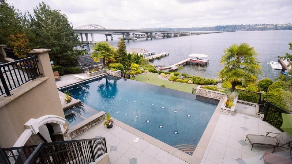 This lake wa home features a koi pond infinity pool for Koi pool and sauna