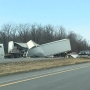 Toll Road semi crash spills dog food on the road