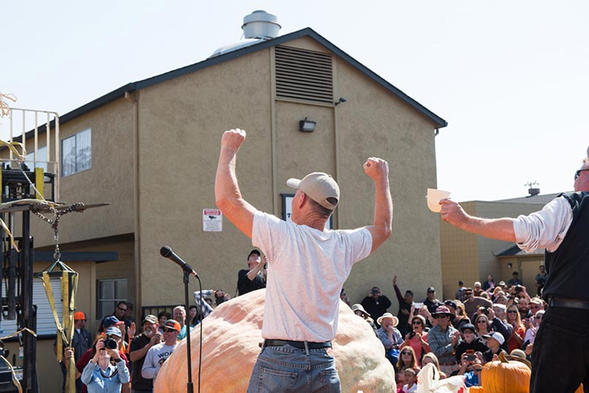 Grower Joel Holland of Sumner celebrates his first-place win. (Photo courtesy of the Half Moon Bay Art & Pumpkin Festival)