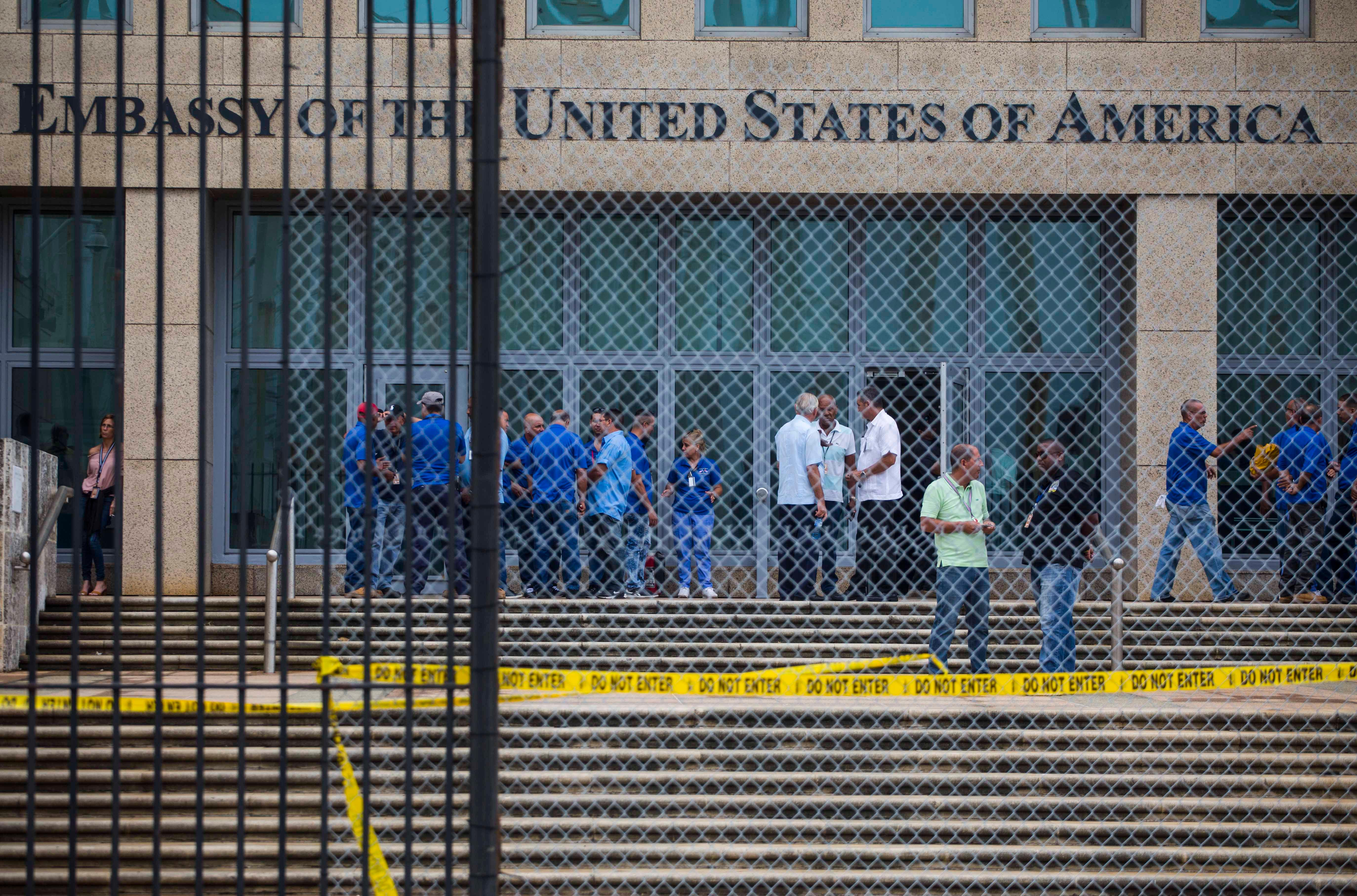 FILE - In a Friday, Sept. 29, 2017 file photo, staff stand within the United States embassy facility in Havana, Cuba. (AP Photo/Desmond Boylan, File)