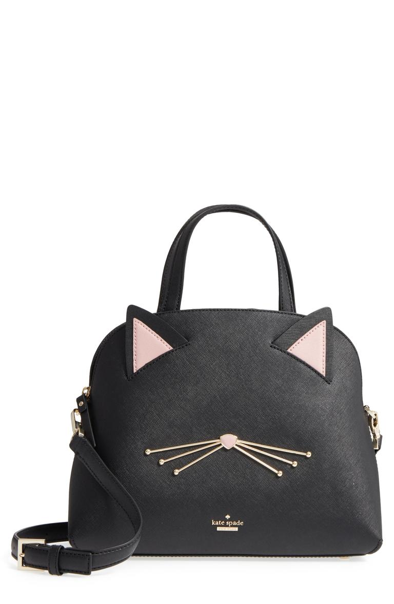 Splurge on this purr-fect black leather satchel with subtle cat ears and whiskers adding a playful feline twist. The purse comes with an adjustable crossbody strap, and its size makes it a great choice for work or play with enough space to hold all of your sommer essentials.{ } (Image: Courtesy Nordstrom)