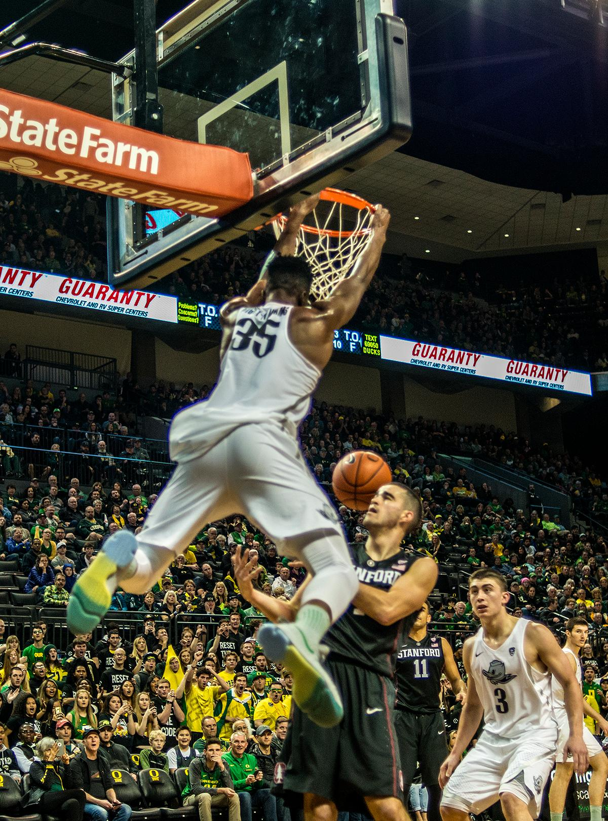 Oregon Ducks Kavell Bigby-Williams (#35) dunks the ball in the second half of the game. The Oregon Ducks continued their winning streak by defeating Stanford (69-52) on Saturday night at Matthew Knight Arena. Chris Boucher led the Ducks with 16 points and 10 rebounds while Dylan Ennis added 15 points. Photo by Rhianna Gelhart, Oregon News Lab