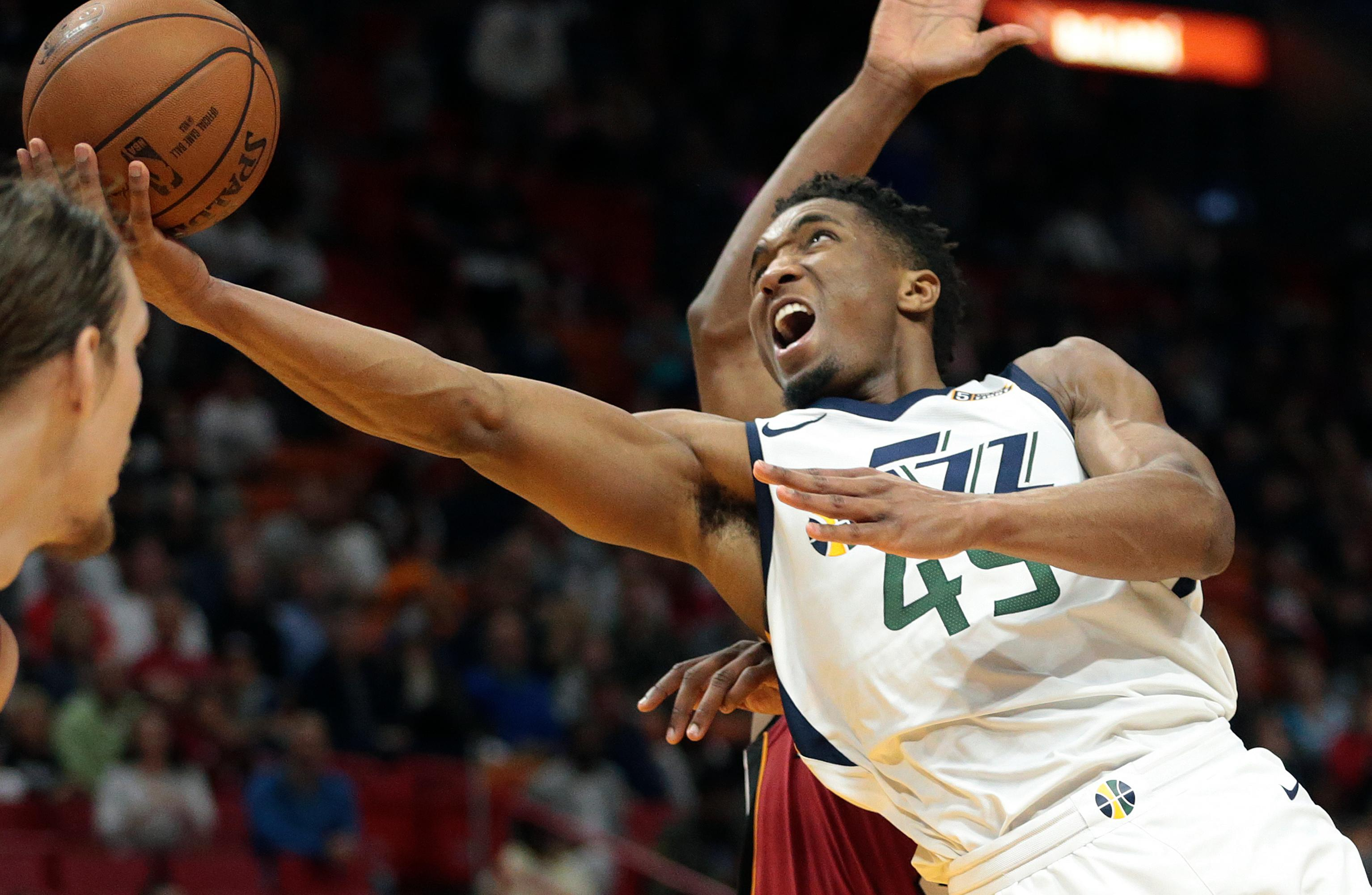 Utah Jazz guard Donovan Mitchell (45) goes to the basket against the Miami Heat during the second half of an NBA basketball game, Sunday, Jan. 7, 2018, in Miami. (AP Photo/Joel Auerbach)