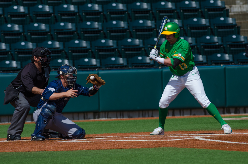 Spencer Steer (13) lets a pitch go by as Alex Guenette (5) makes the cath. In the second of the three game series, the Ducks beat the UC Irvine Anteaters 6-3. Photo by Levi Gittleman, Oregon News Lab