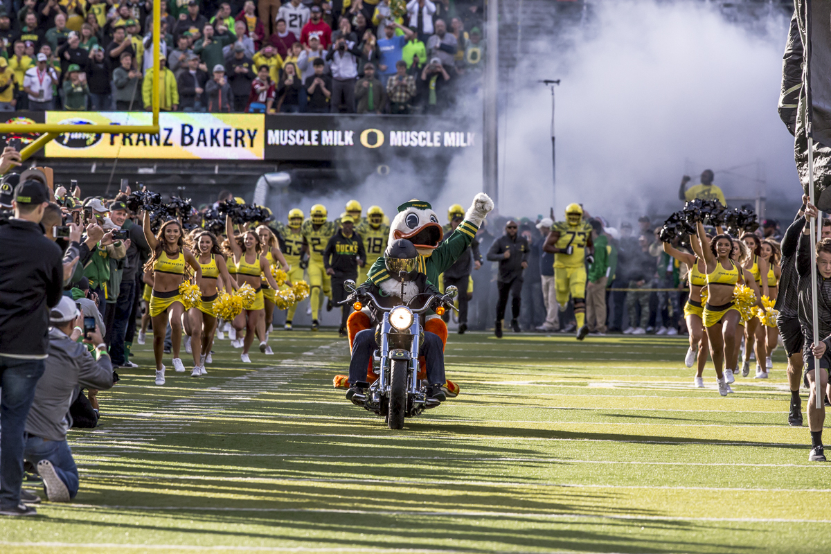 The Oregon Duck leads the team onto the field before the first half. The Oregon Ducks trail the Washington State Cougars 10 to 13 at the end of the first half. Photo by Ben Lonergan, Oregon News Lab