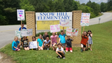 """We want Burk!"": Parents, students protest Snow Hill Elementary principal's reassignment"