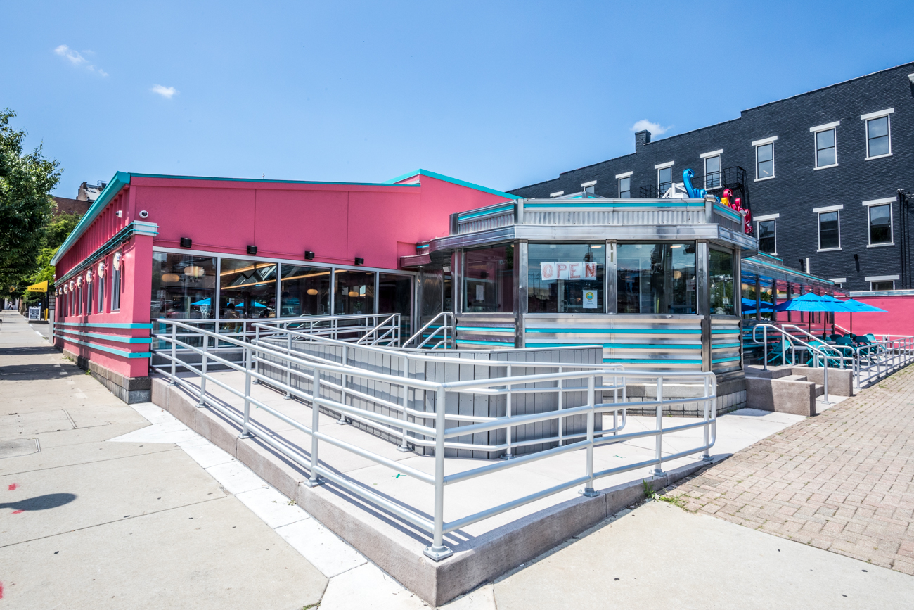 They didn't cut corners when it came to decorating the OTR location. The bright interior mirrors that of the original Reading Road location, featuring breakfast-themed murals, colorful seating, and plenty of rubber ducks to decorate the space. To top it off, it has a matching pink and blue exterior paint job, as well. / Image: Catherine Viox // Published: 7.31.20