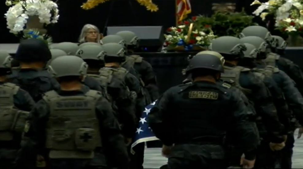 Members of the Bibb County Sheriff's Office SWAT Team, which Freeman was a part of, carry Freeman's casket into the ceremony / WGXA