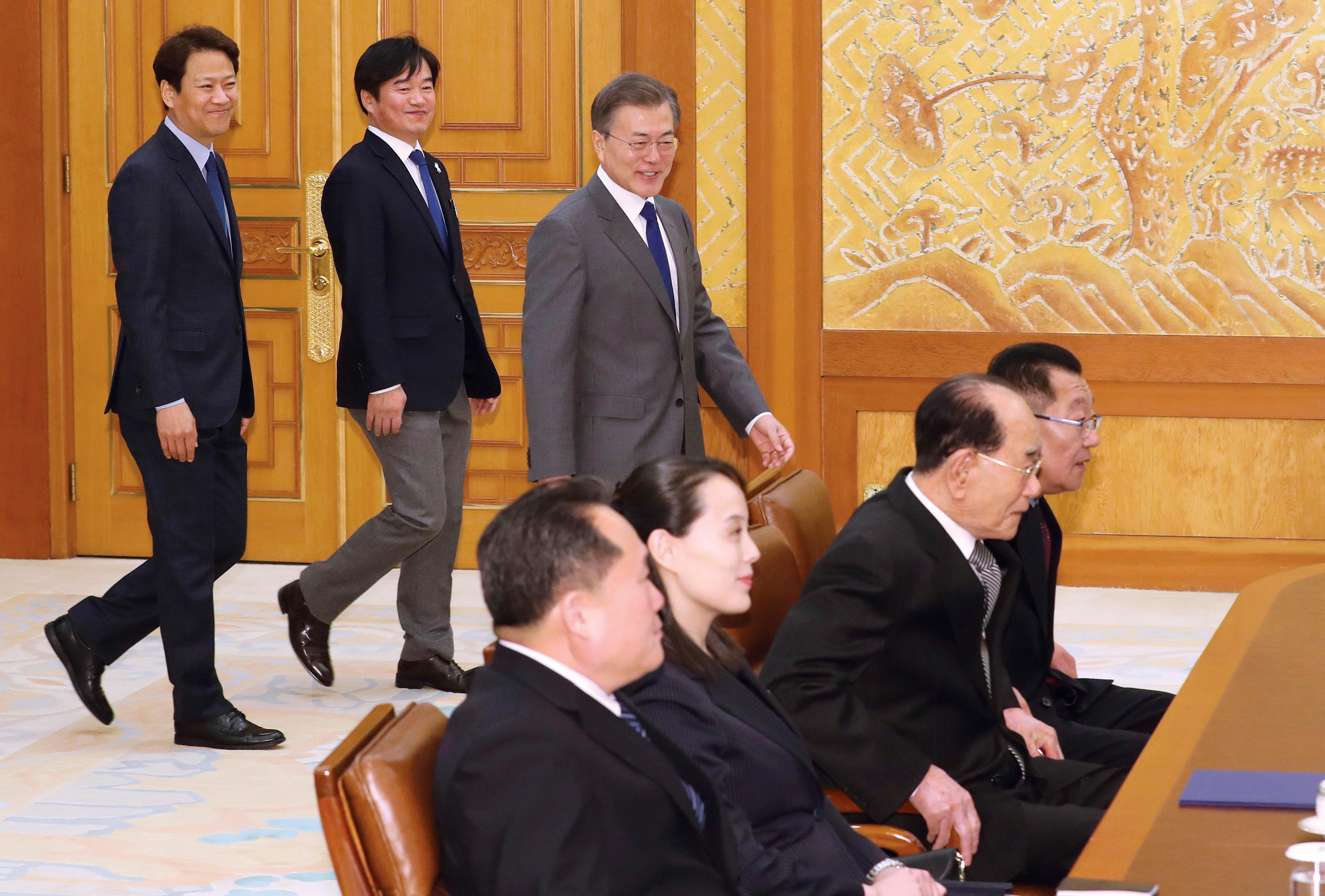 South Korean President Moon Jae-in, right rear, arrives to meet a North Korean delegation including Kim Yo Jong, second from left at front, sister of North Korean leader Kim Jong Un,  at the presidential house in Seoul, South Korea, Saturday, Feb. 10, 2018. President Moon on Saturday met with the senior North Korean officials over lunch at Seoul's presidential palace in the most significant diplomatic encounter between the rivals in years.(Kim Ju-sung/Yonhap via AP)