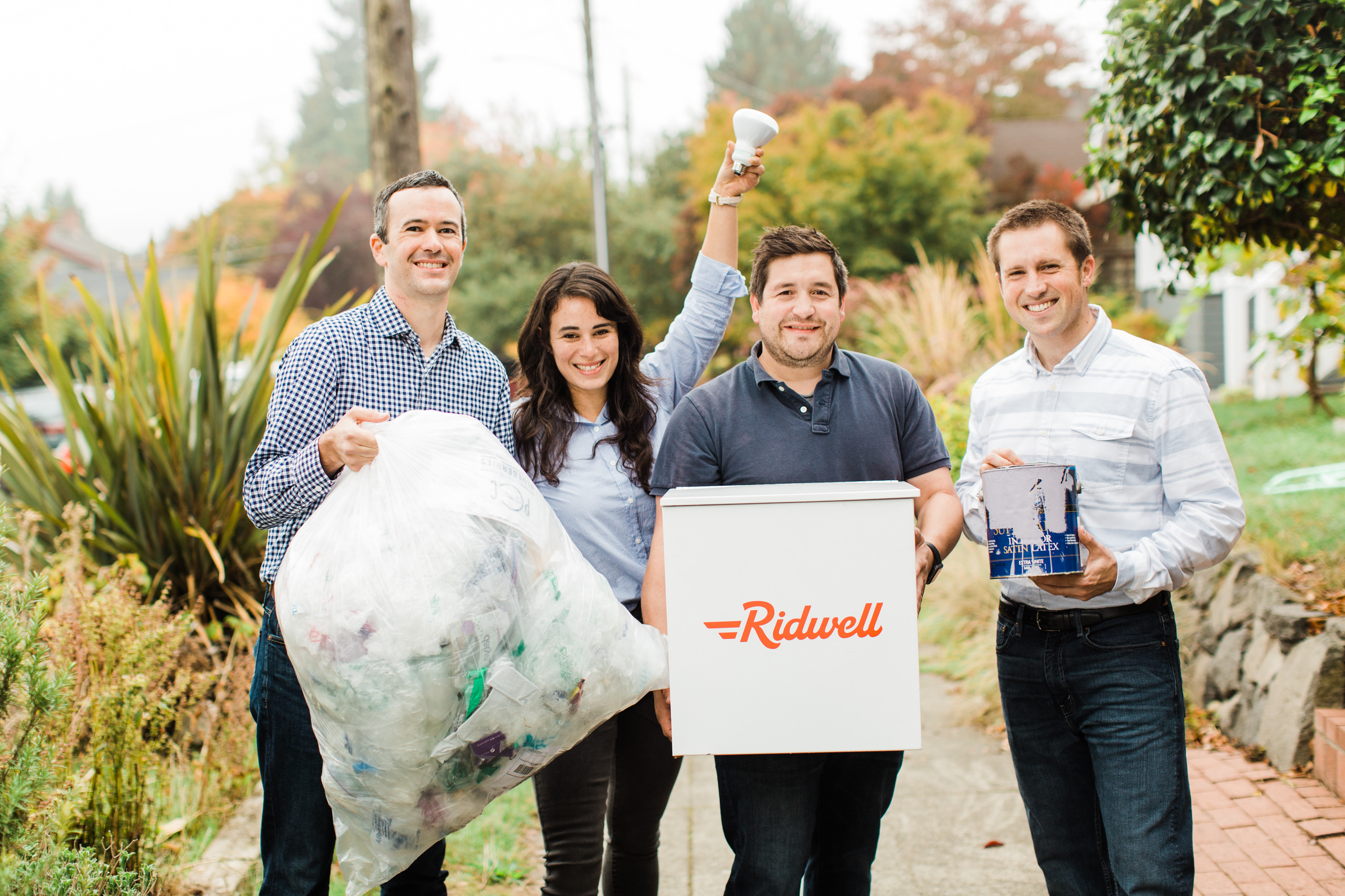 The founders of Ridwell with some of the stuff they take. Left to right;{ }Ryan Metzger, Aliya Marder, Justin Gough, and David Dawson. (Image:{ }Marissa Ciccarelli)