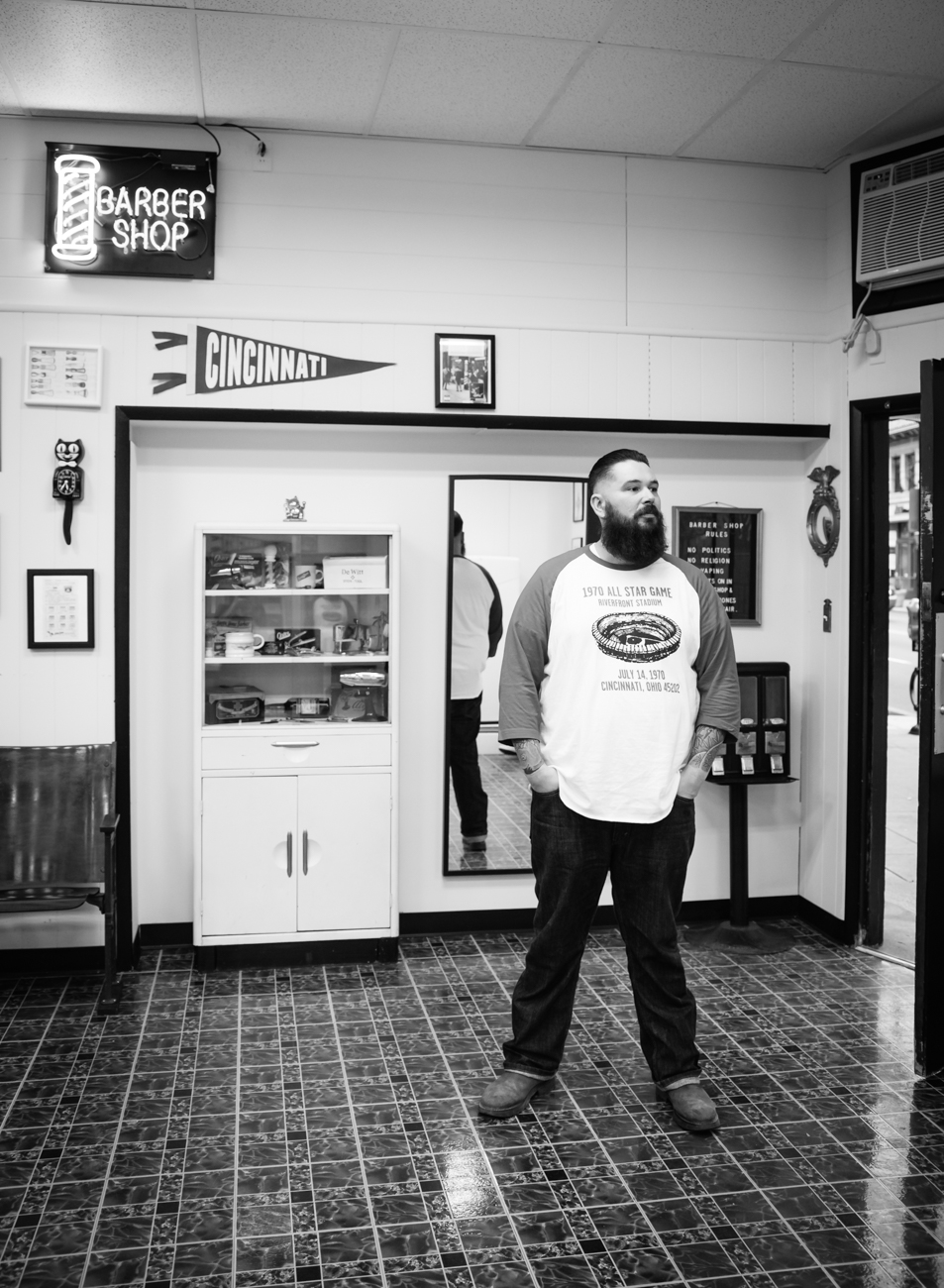 Andy Mobarry is the new owner of Clifton Barbers. He hopes customers who come to his retro-themed shop will share some genuine conversation, which is why there's no TV. / Image: Melissa Doss Sliney // Published: 3.13.17