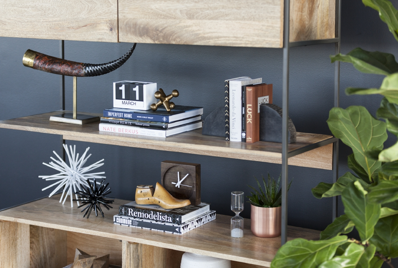 This modern and minimalist wooden shelving is perfect for an urban couple. Stack color-coordinated books to create clean lines and an element of style. (Image: Courtesy Havenly)