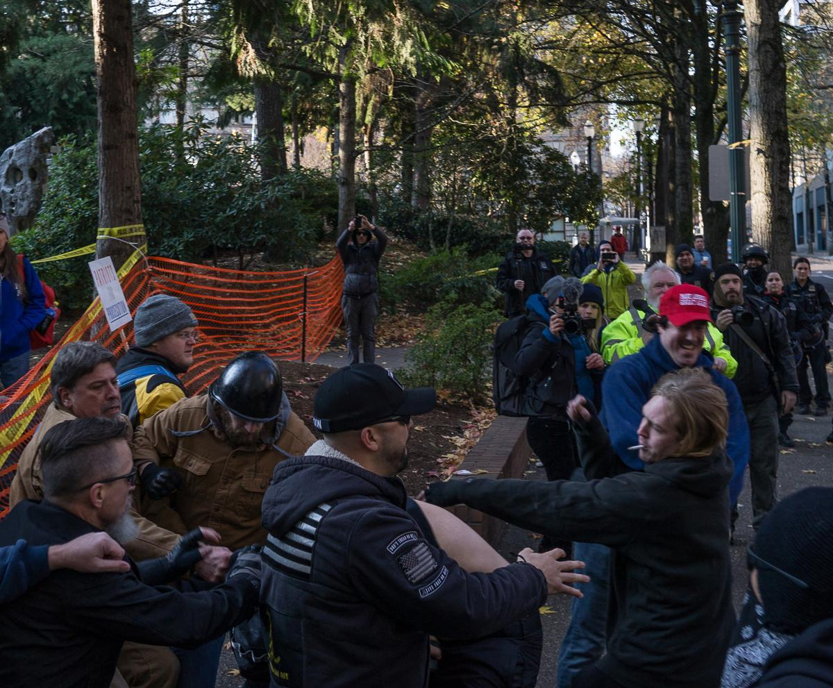 Members of Antifa clash with Patriot Prayer rally goers in Terry Schrunk Plaza. A demonstration by the alt-right, conservative group Patriot Prayer began at 1 p.m. in Portland, Ore., on Saturday, December 9, to protest the homicide acquittal of Jose Ines Garcia Zarate, the undocumented immigrant who accidentally shot and killed Kate Steinle in San Francisco. The demonstration attracted a large crowd of counter-protesters and members of Antifa, and heated exchanges and several scuffles occurred between the two groups throughout the afternoon until the event's conclusion at 4 p.m., with at least one member of Patriot Prayer being detained by police and several demonstrators being injured. The rally began in Portland's Terry Schrunk Plaza and developed into a march along the Tom McCall Waterfront Park before ending at Terry Schrunk Plaza again. Photo by Kit MacAvoy, Oregon News Lab