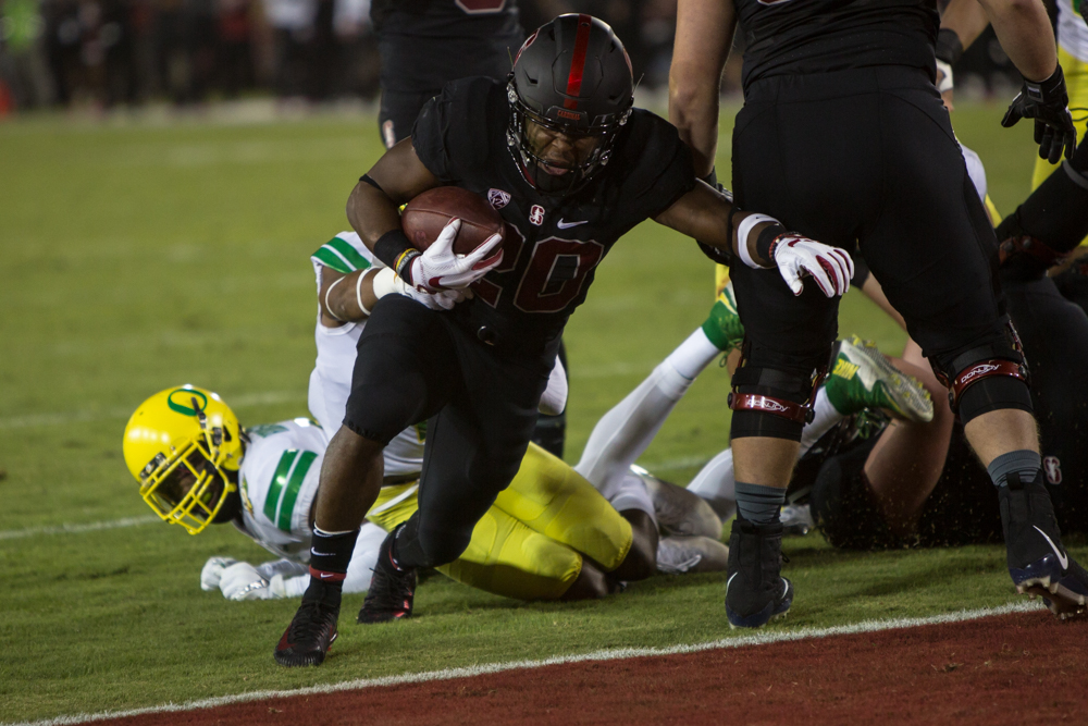 Stanford running back Bryce Love (#20) runs into the endzone for a touchdown. The Oregon Ducks are trailing the Stanford Cardinal 28-7 at halftime at Stanford Stadium in California.  Photo by Austin Hicks, Oregon News Lab