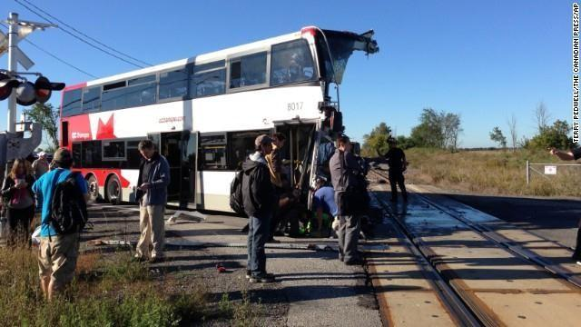 People stand next to the destroyed bus on September 18.
