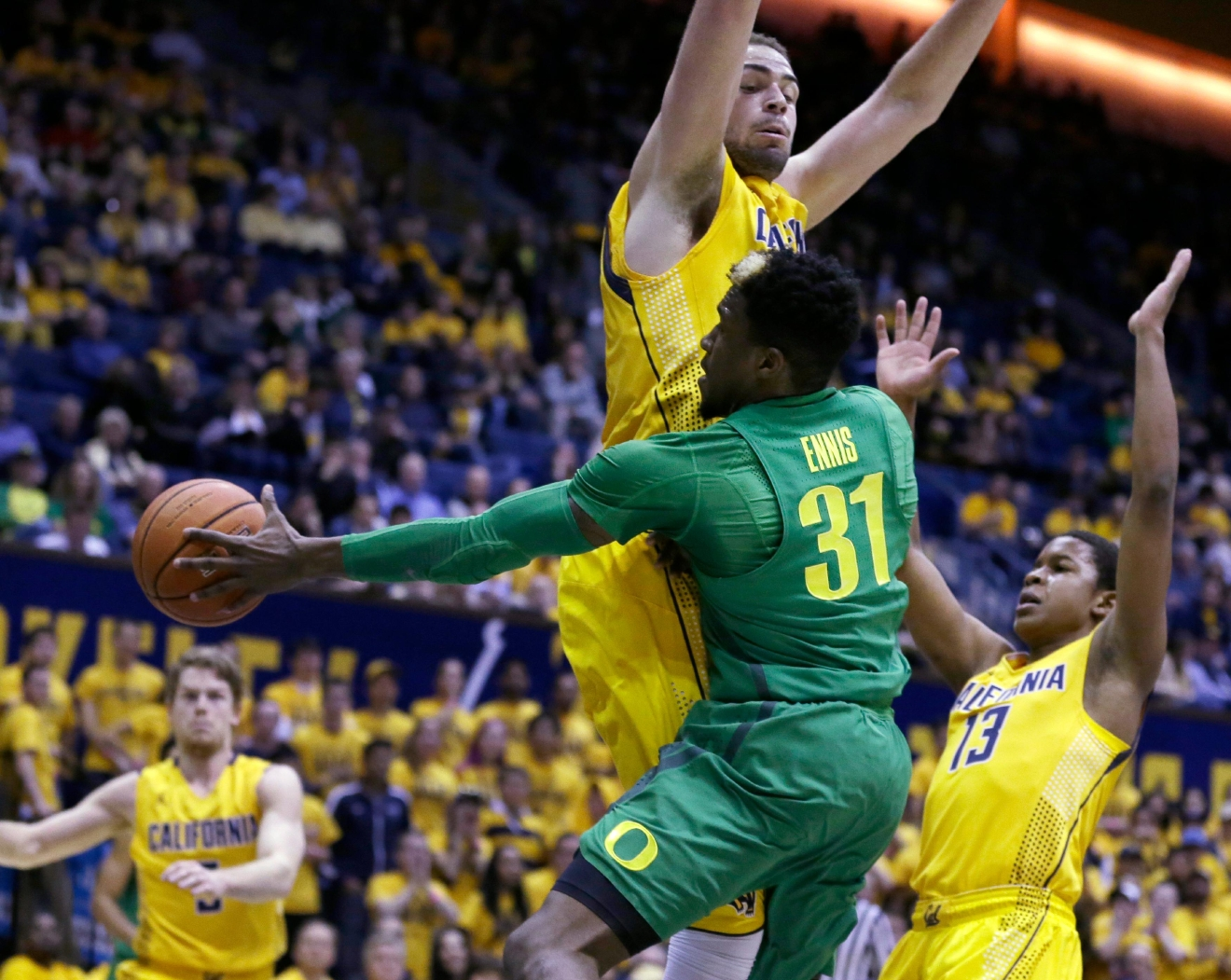 Oregon's Dylan Ennis (31) passes away from California's Kameron Rooks and Charlie Moore (13) in the first half of an NCAA college basketball game, Wednesday, Feb. 22, 2017, in Berkeley, Calif. (AP Photo/Ben Margot)