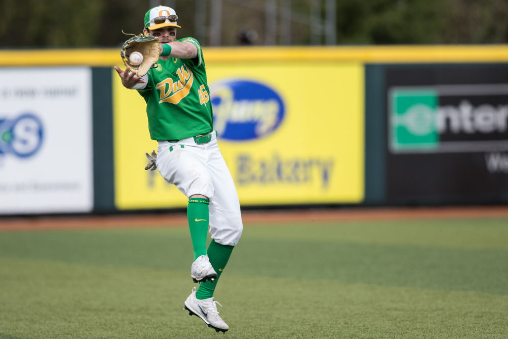 Oregon Ducks outfielder Taylor Travess (#46) catches a ball off a bounce from a UC Irvine batter. Oregon Ducks pitcher Matt Mercer (#11) throws a pitch.  In the second of the three game series, the Ducks beat the UC Irvine Anteaters 6-3. Photo by Austin Hicks, Oregon News Lab