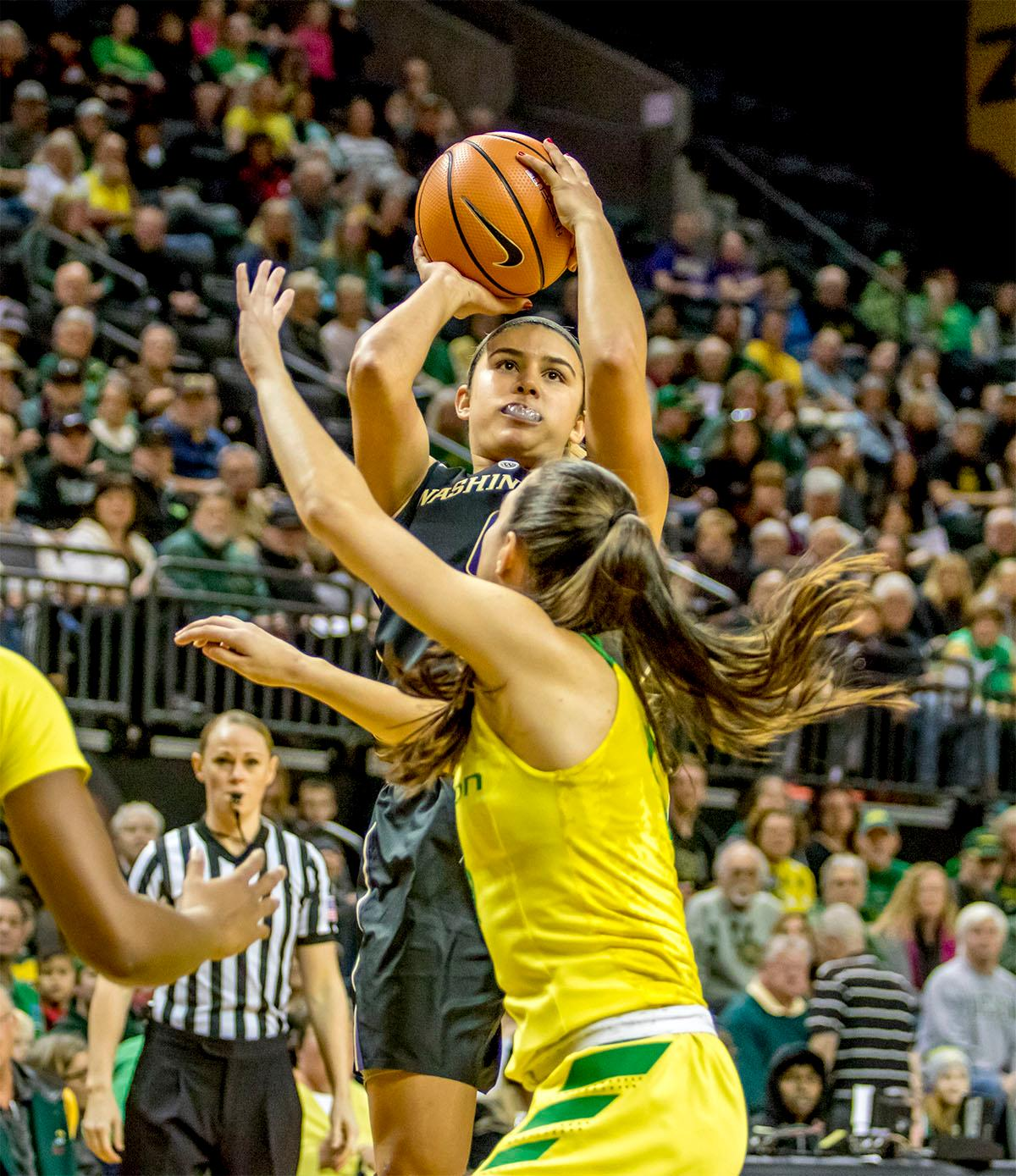 The Huskies' Amber Melgoza (#4) goes up for a shot against the Ducks. The Oregon Ducks defeated the Washington Huskies 94-83 on Sunday at Matthew Knight Arena. The victory was Head Coach Kelly Graves' 500th career win. Sabrina Ionescu also set the new NCAA all time record of 8 triple doubles in just 48 games. The previous record was 7 triple doubles in 124 games, held by Susie McConnell at Penn State. The Ducks will next face off against USC on Friday January 5th in Los Angeles. Photo by August Frank, Oregon News Lab