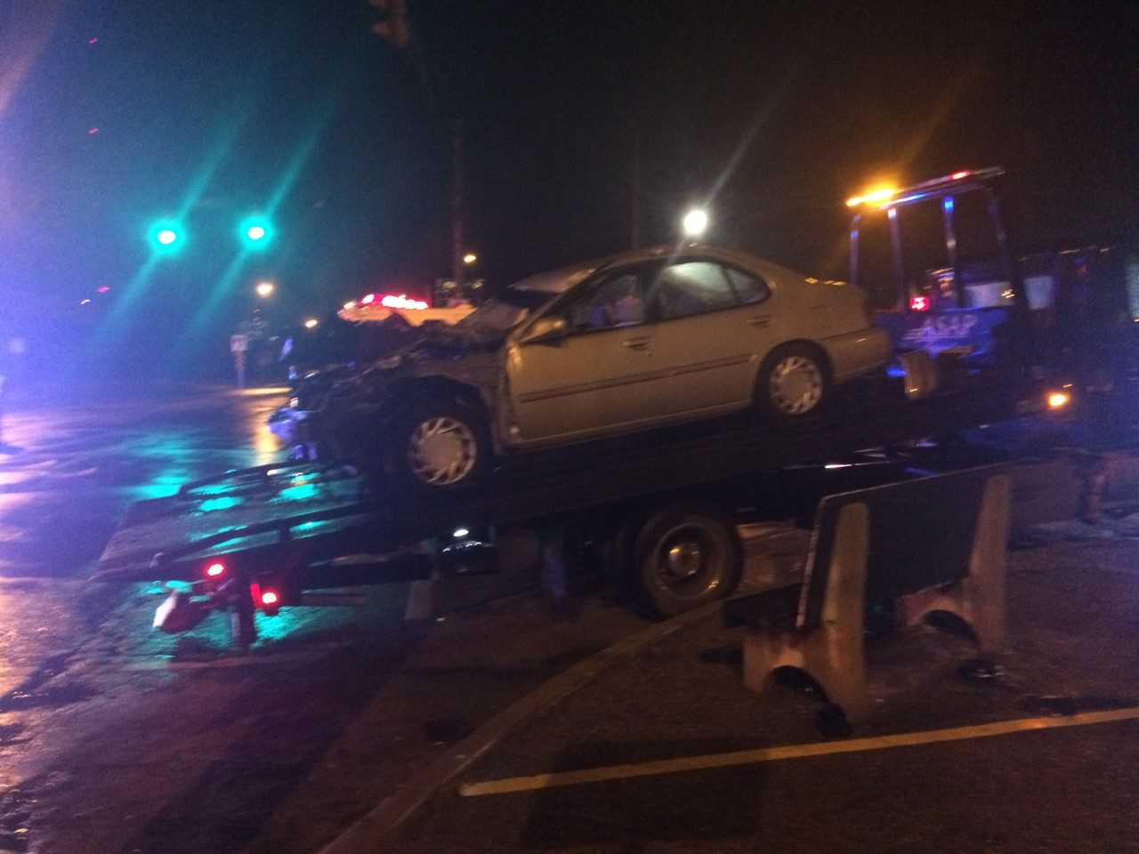 A woman was sent to the hospital Thursday morning after a crash caused her car to be wedged beneath a semi.<p></p>