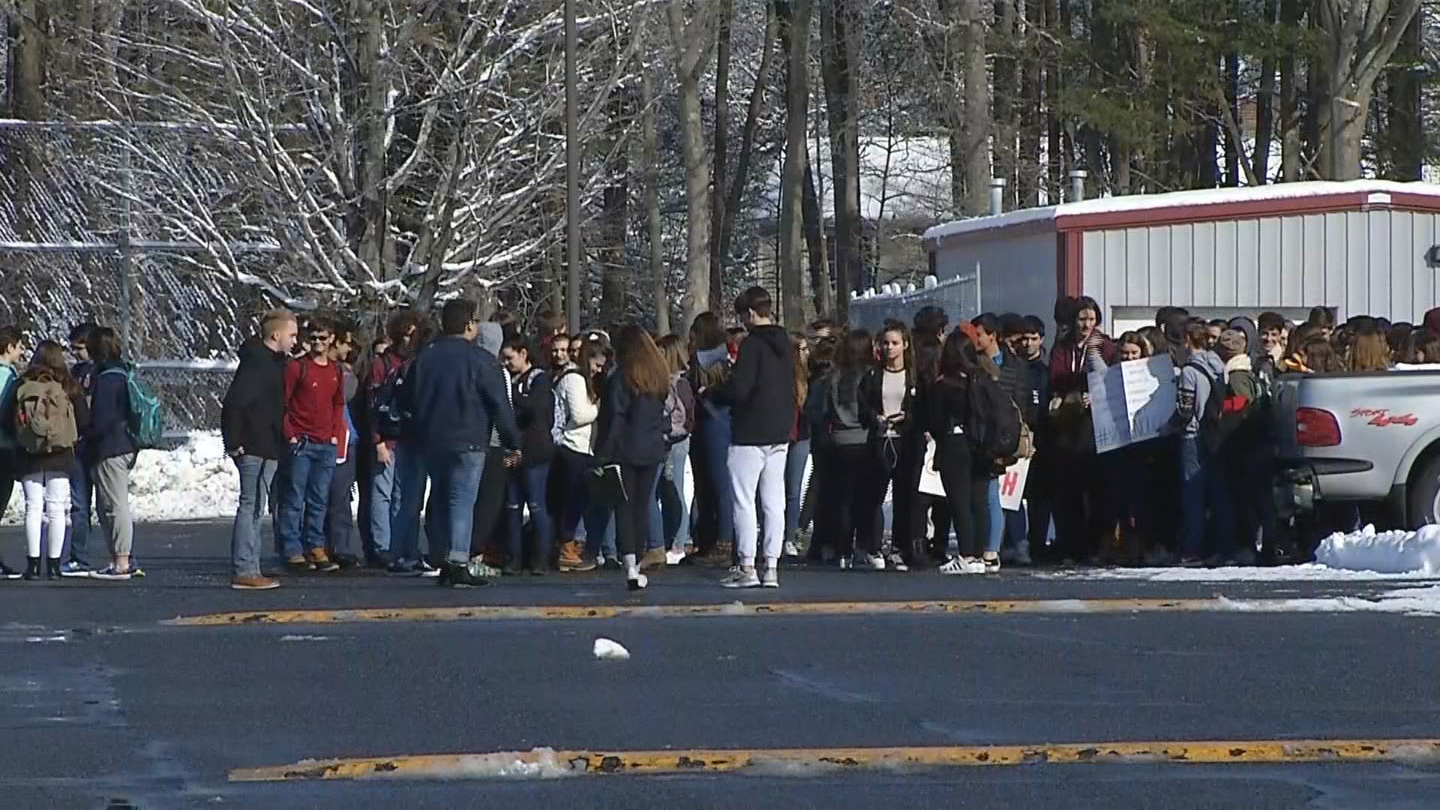 Students at Seekonk High School walk out of class on Wednesday, March 14, 2018, in memory of the victims of the school shooting in Parkland, Florida. (WJAR)