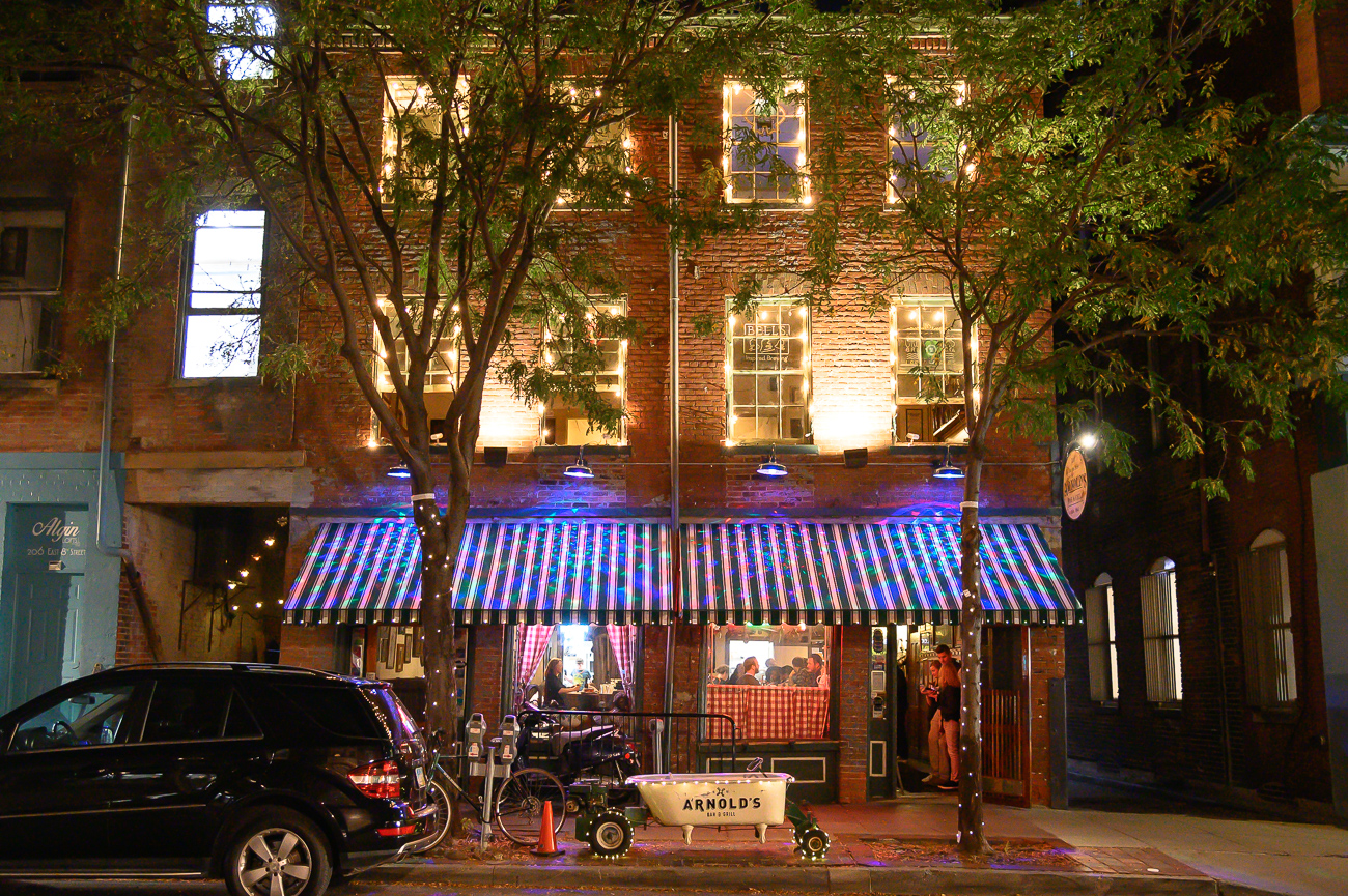 PICTURED NEIGHBORHOOD: Downtown / Alright, so this one isn't an official BLINK installation, but it's worth noting. Arnold's Bar & Grill, Cincinnati's oldest bar, is all lit up and looking good for BLINK. / Image: Phil Armstrong // Published: 10.12.19