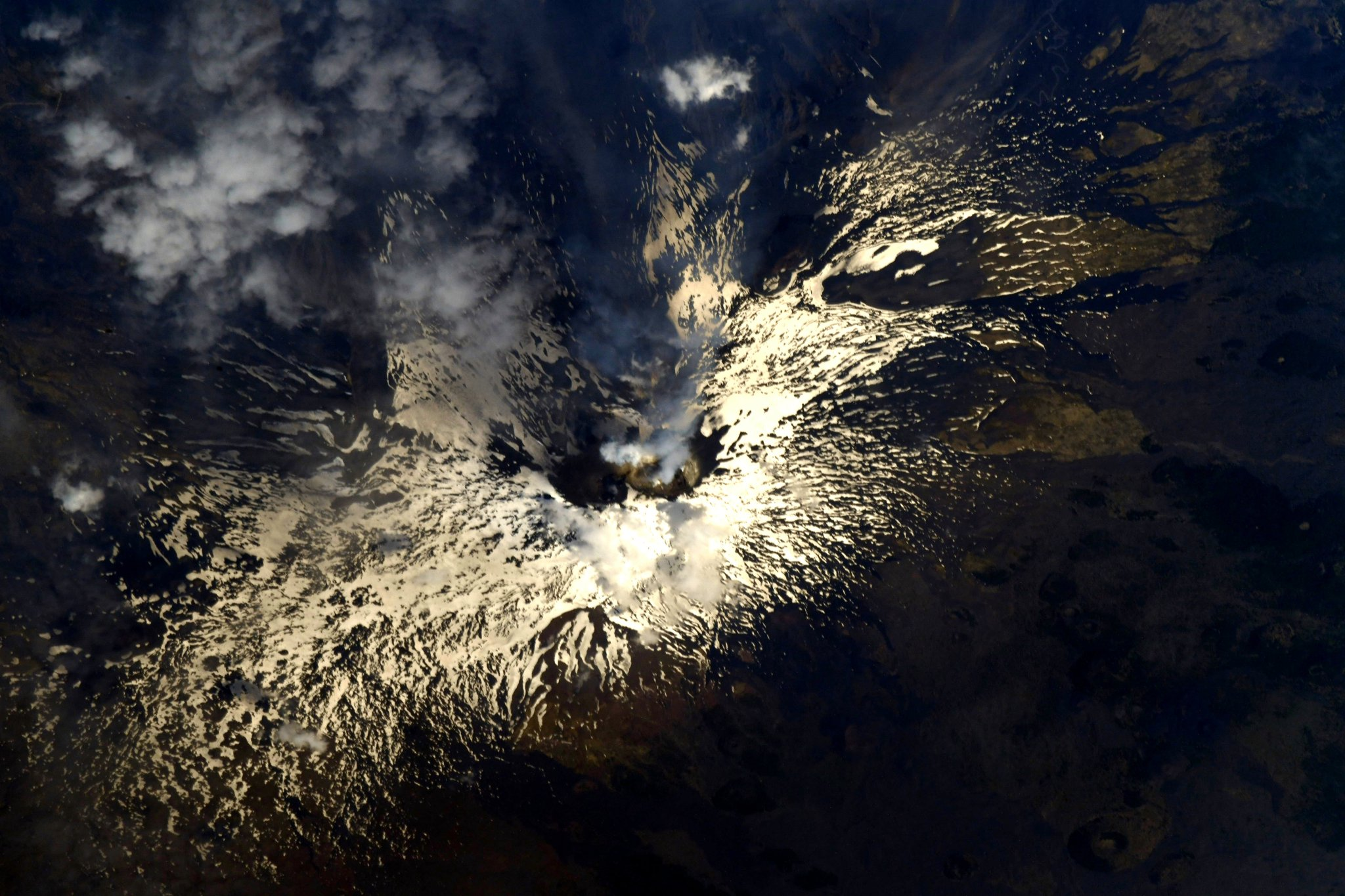 The smoldering cauldron of Mount Etna on the island of Sicily. #Italy (Photo & Caption: Ricky Arnold / NASA)