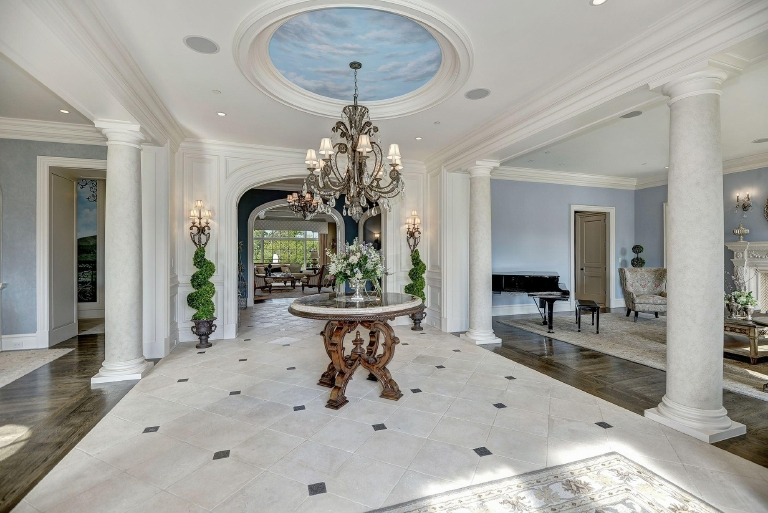 This gorgeous home, listed by Mark McFadden and Tricia Messerschmitt of Washington Fine Properties, is sited on three verdant acres in the luxurious gated neighborhood of Creighton Farms in Aldie, VA. Every inch of the seven-bedroom/13-bath French Provincial house has designer finishes and the latest high-tech gadgets, including Savant's integrated smart home automation system. The decor and layout manages to straddle the line between old-world elegance (I mean look at the oak-paneled library and the crystal chandelier dangling above the kitchen island) and modern day convenience -- did I mention there is a wine cellar/tasting room/wet bar that could probably fit my entire apartment in it?? Oh and how could I forget to mention the private pool (which is in addition to the TWO community pools available to Creighton Farms residents), the billiards room, the home theater! Last, but certainly not least, are the amazing amenities of the Creighton Farms area, that will have residents feeling like they are perpetually on vacation! From the Jack Nicklaus Signature Golf Course to four tennis courts, the Audubon sanctuary,  clubhouse and a 24-7 concierge who can handle everything from  dinner reservations at the best restaurant in town to finding a babysitter for the kids! Tour the rest of the house in our gallery and visit WFP.com for more info on the lot! (Image: HomeVisit)