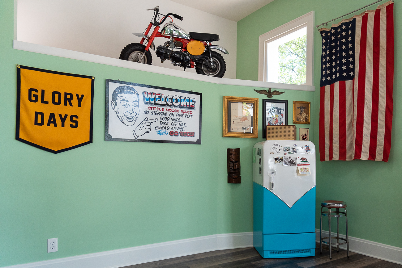The barbershop is filled with eclectic decor. From old-timey machinery and trinkets to a velvet Elvis painting, seafoam green walls, and a taxidermied zebra head, there's no shortage of visuals inside the shop. / Image: Phil Armstrong, Cincinnati Refined // Published: 7.10.20