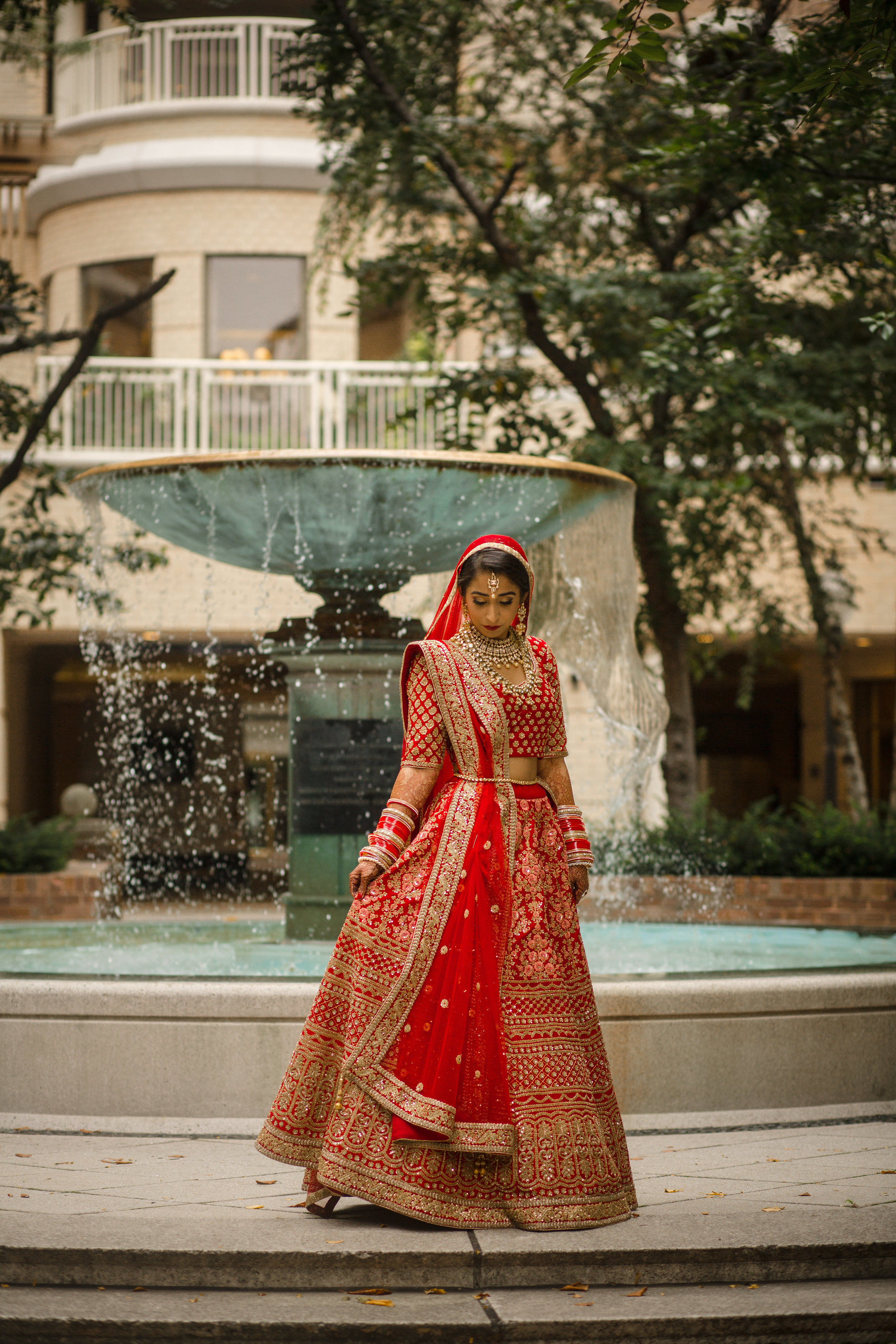 Manmeet wore{ } Sajda by Suman for her Sikh ceremony in the morning. Her evening reception dress was by the same designer. Her Western wedding gown was from{ }BHLDN. (Image: Laura Bryan Photography){ }