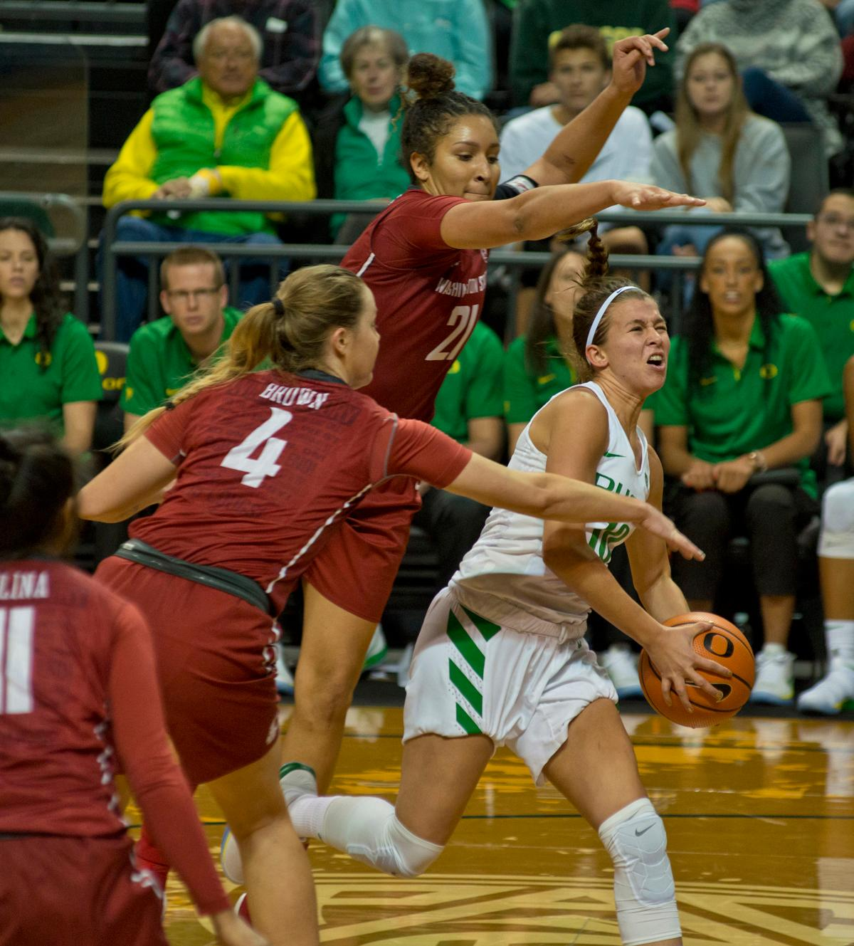 University of Oregon Ducks Lexi Bando (#10) attempts to drive to the basket past the defense of Washington State University Cougars Louise Brown (#4) and Nike McClure (#21). In their first conference basketball game of the season, the Oregon Women Ducks defeated the Washington State University Cougars 89-56 in Matt Knight Arena Saturday afternoon. Oregon's Ruthy Hebard ran up 25 points with 10 rebounds. Sabrina Ionescu shot 25 points with five three-pointers and three rebounds. Lexi Bando added 18 points, with four three-pointers and pulled down three rebounds. Satou Sabally ended the game with 14 points with one three-pointer and two rebounds. The Ducks are now 12-2 overall with 1-0 in conference and the Cougars stand at 7-6 overall and 0-1 in conference play. The Oregon Women Ducks next play the University of Washington Huskies at 1:00 pm on Sunday. Photo by Dan Morrison, Oregon News Lab