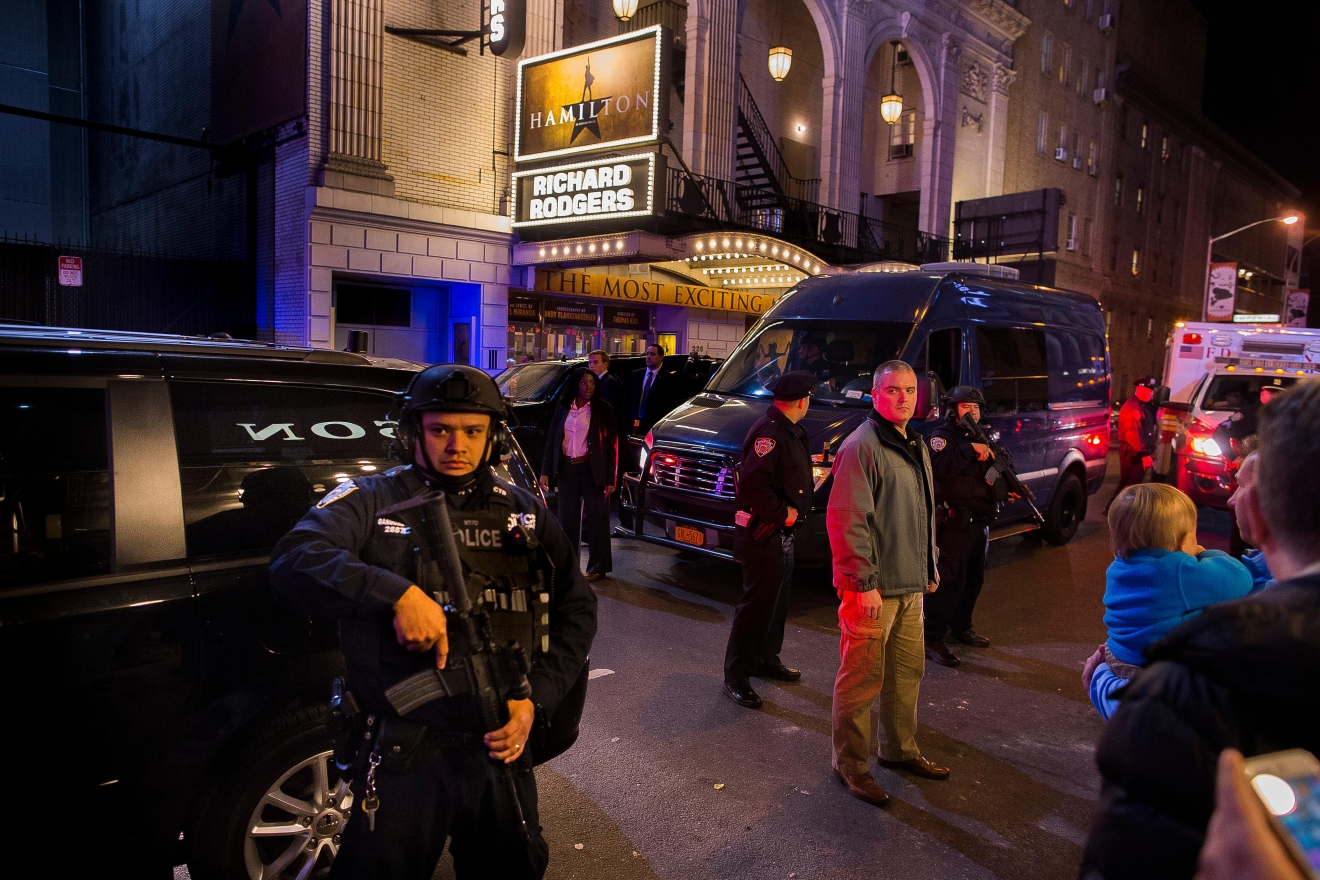 "Heavily armed police stand guard as a motorcade carrying Vice President-elect Mike Pence, center, leaves the Richard Rodgers Theatre after a performance of ""Hamilton,"" in New York, Friday, Nov. 18, 2016. (AP Photo/Andres Kudacki)"