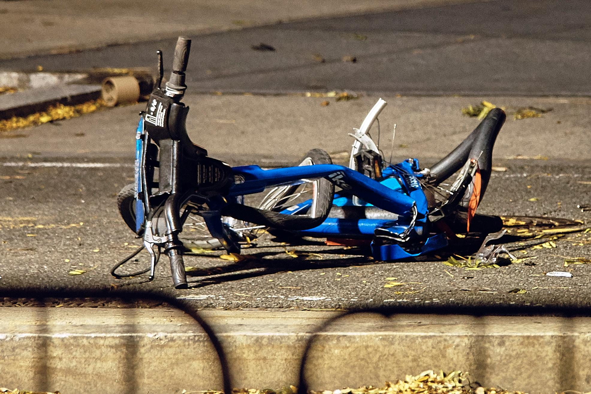 A bicycle lies on a bike path at the crime scene where a motorist earlier Tuesday drove onto the path near the World Trade Center memorial, striking and killing several people, Wednesday, Nov. 1, 2017, in New York. (AP Photo/Andres Kudacki)