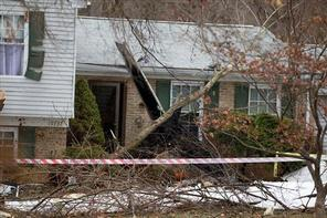 The wreckage of the plane that crashed into a house in Gaithersburg, Md., Monday Dec. 8, 2014. (AP Photo/Jose Luis Magana)