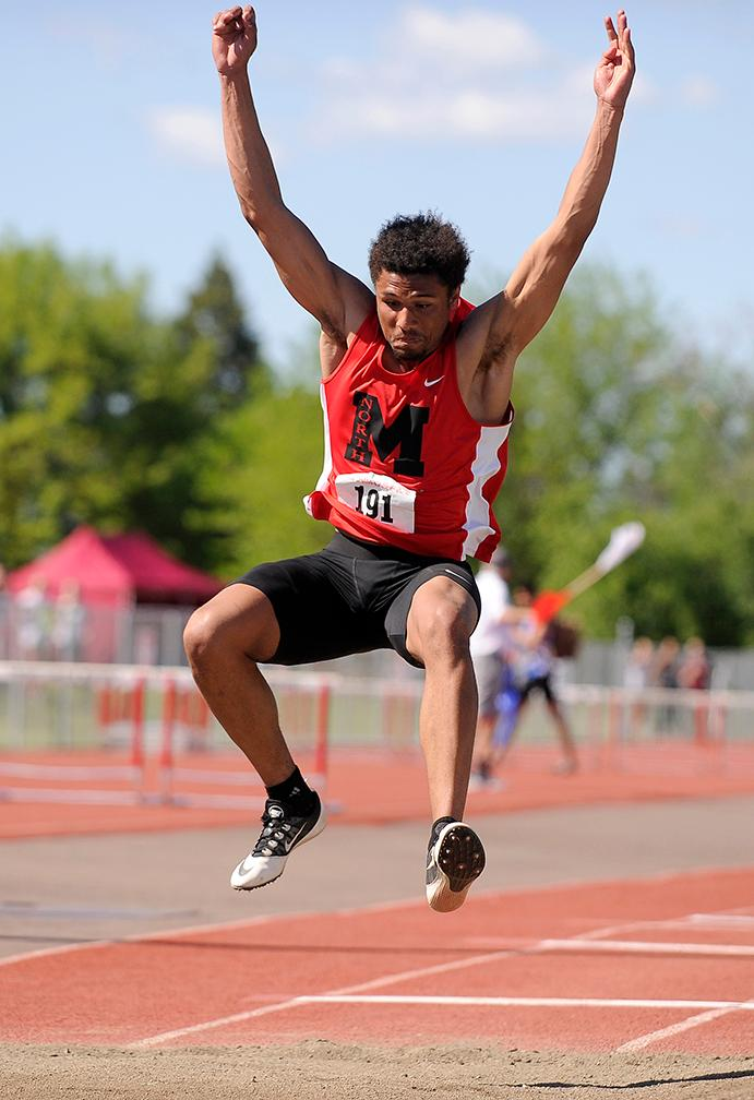 Andy Atkinson / Mail TribuneNorth Medford's Kaison Faust makes his final attempt in the finals winning the triple jump at the SWC Championships meet at North Medford High School Saturday.