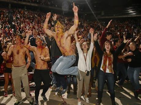 Florida State fans react as they watch a touchdown in the final seconds of the BCS Championship football game between Florida State and Auburn on a 30-foot screen at the Tallahassee Leon County Civic Center on Monday, Jan. 6, 2014, in Tallahassee, Fla.